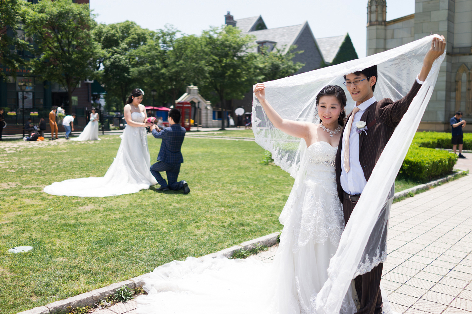 A young couple poses in  June 2015, in front of the church, a popular backdrop for wedding photos.