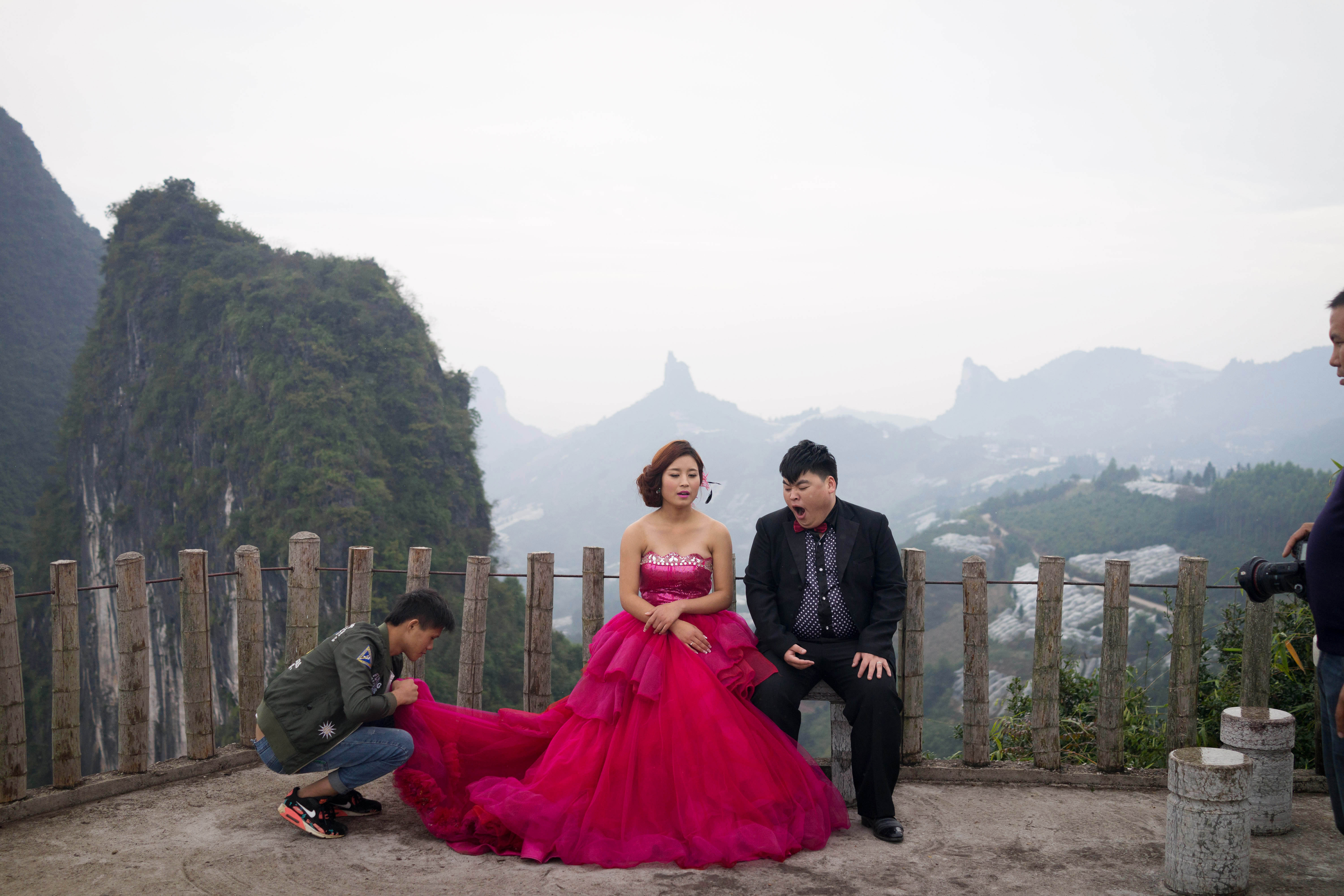 A couple poses for photos in Guilin, southern China known for its dramatic landscape, in November 2015.