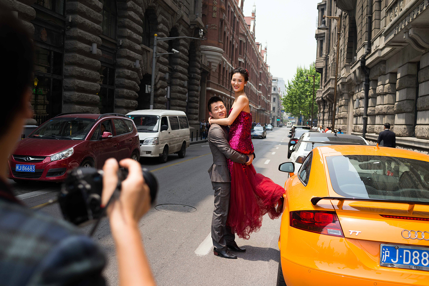 A couple is photographer on the streets of the Bund in Shanghai in April 2015.