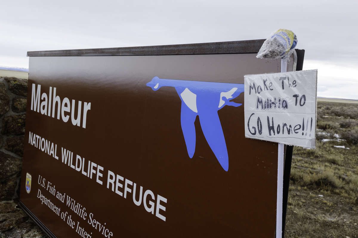 A mop and sign are taped to a sign for the occupied Malheur National Wildlife Refuge near Burns, Oregon  on Jan. 29, 2016.