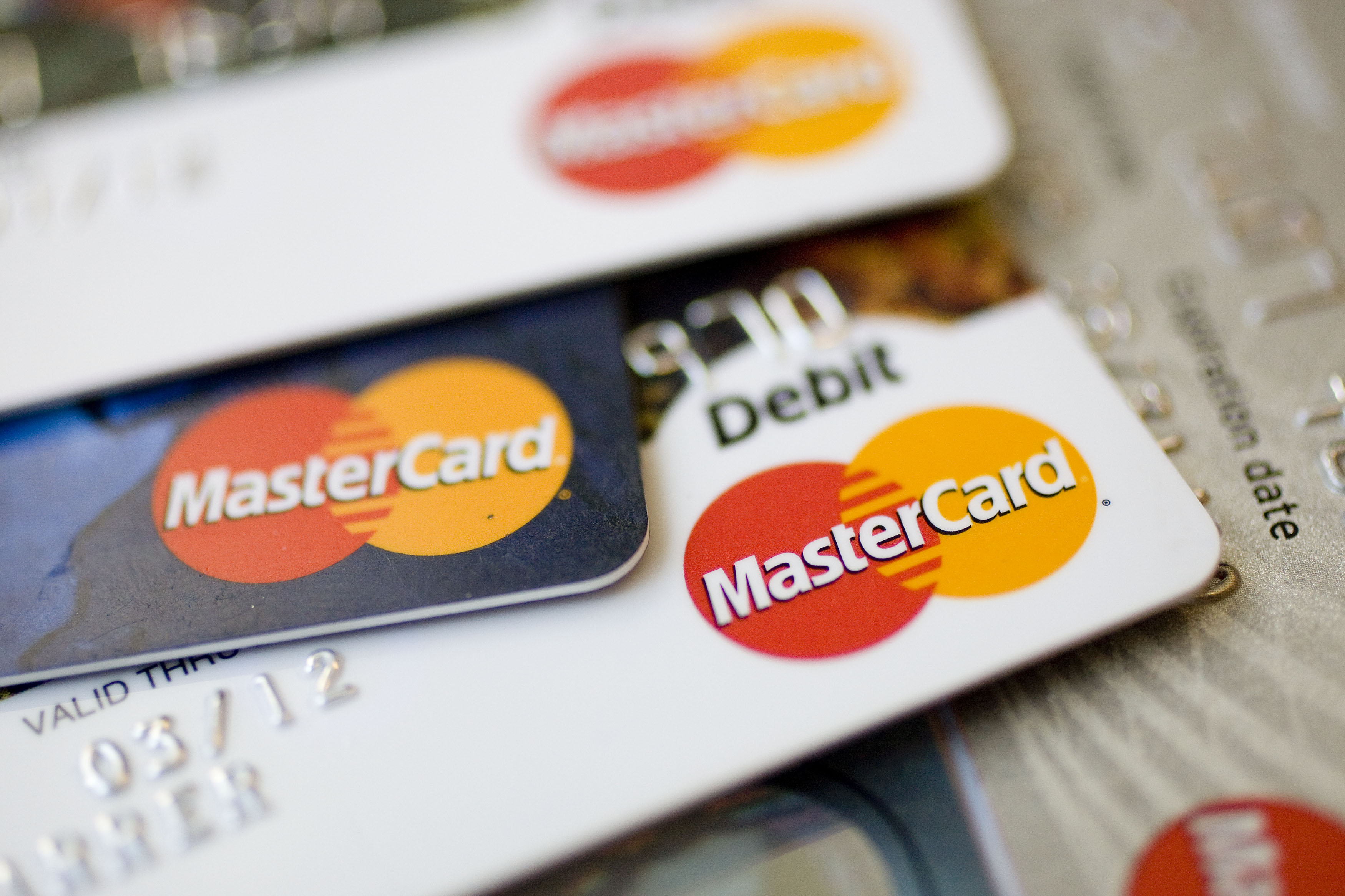 MasterCard logos appear on credit and debit cards arranged for a photograph in New York, U.S., on Thursday, July 30, 2009.