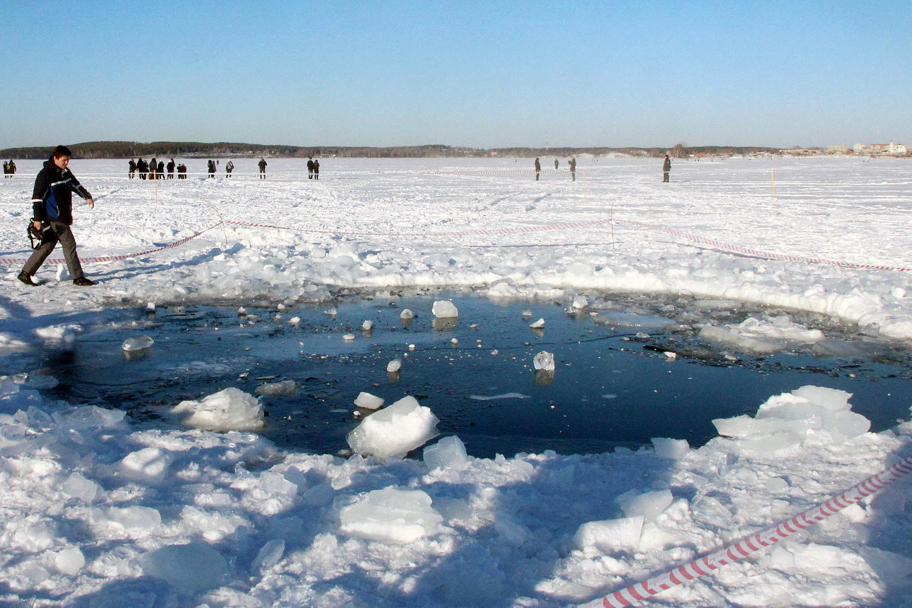 A hole on the ice of Chebarkul Lake in the Russian region of Chelyabinsk, believed to have been made by a meteor fragment, is shown on Feb. 16, 2013.