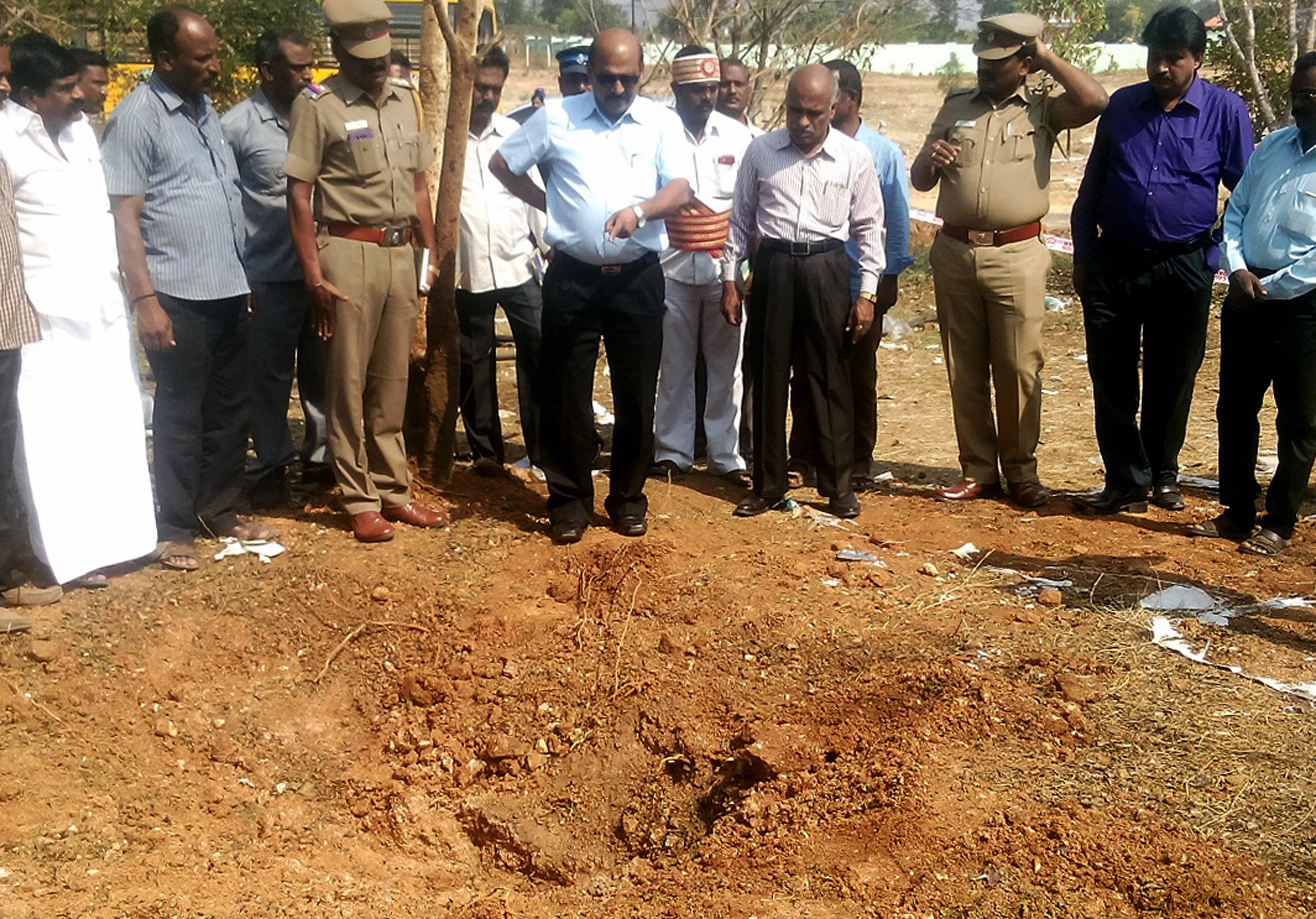 Indian authorities inspect the site of a suspected meteorite landing on Feb. 7, 2016 in Vellore district in southern Tamil Nadu state, on Feb. 6, 2016.