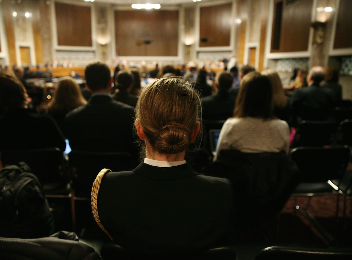 U.S. Navy LCDR Stephanie Hayes listens to testimony about women in the military during a Senate Armed Services Committee hearing on Capitol Hill, Feb. 2, 2016 in Washington, DC.