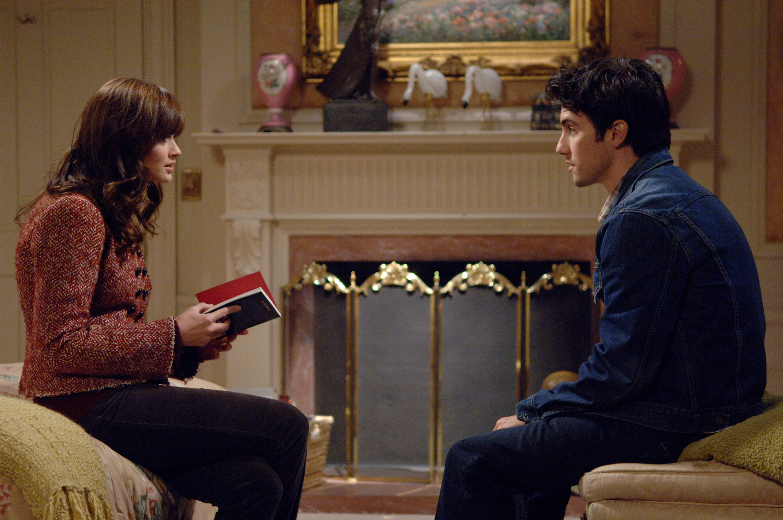 Milo Ventimiglia, who played the role of Jess on Gilmore Girls, sits with Alexis Bledel, who played Rory.