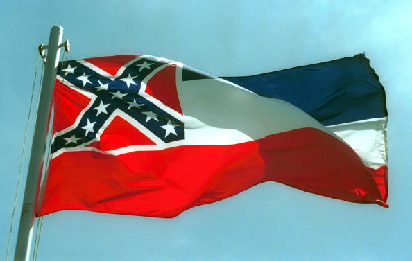 The Mississippi State flags flies April 17, 2001 in Pascagoula, Miss.