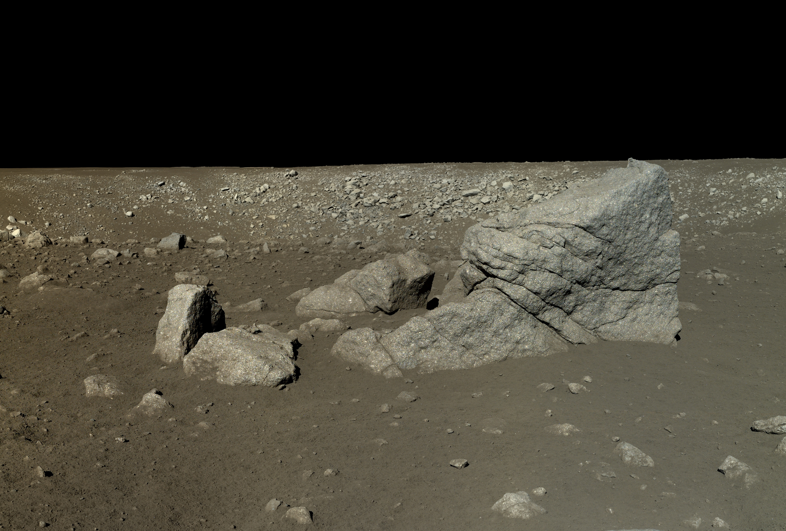 This is a mosaic of six images captured by the Yutu rover on Jan. 13, 2014, after it had driven southwest of the lander to visit a large block of impact ejecta that the team named Long Yan (Pyramid Rock).