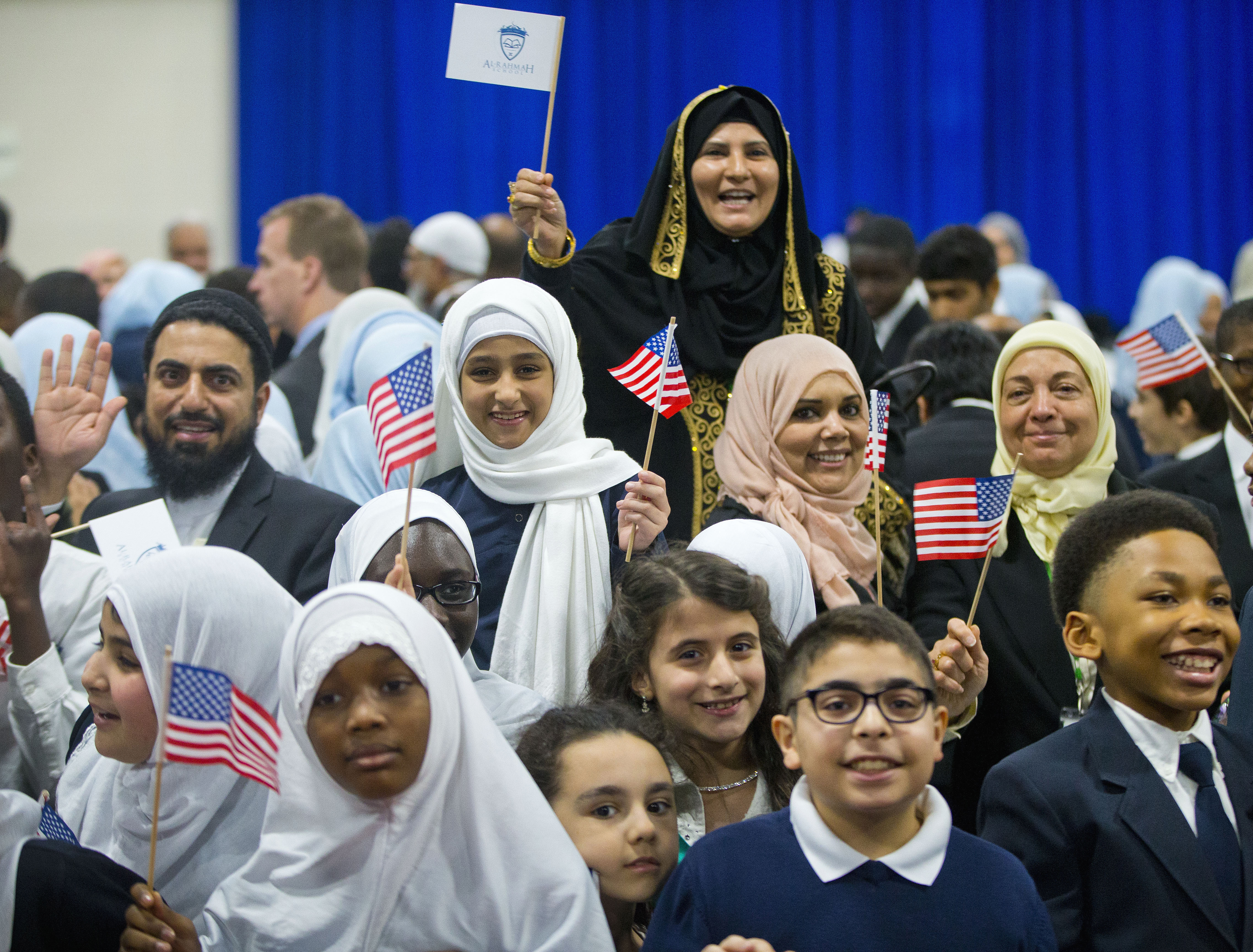 Children from Al-Rahmah school and other guests react after seeing President Barack Obama during his visit to the Islamic Society of Baltimore, on Feb. 3, 2016.