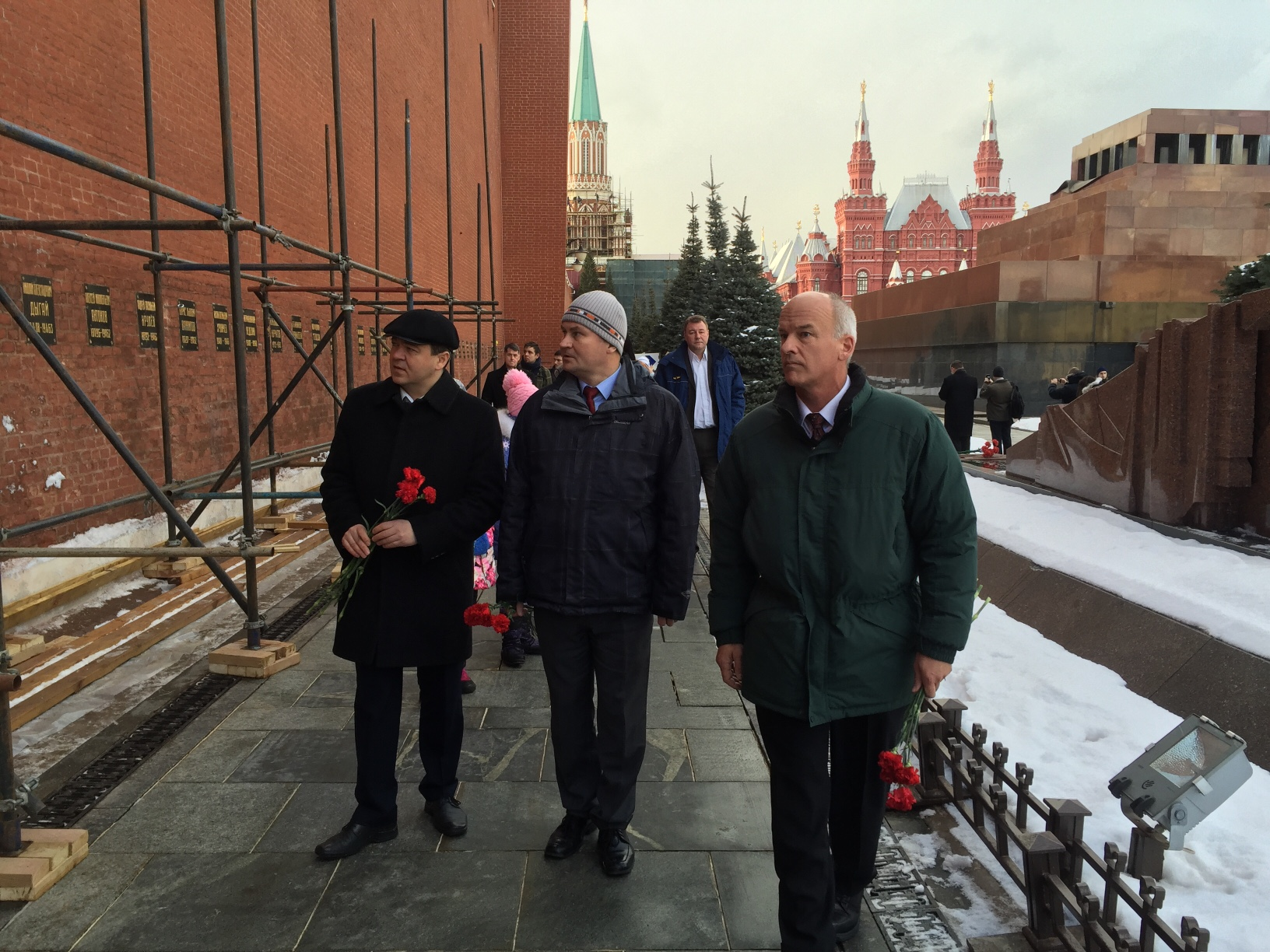 NASA astronaut Jeff Williams, right, along with Russian Cosmonauts Oleg Skripochka, left, and Alexey Ovchnin prepare for a ceremonial laying of flowers at the graves of Yuri Gagarin and Sergey Korolev outside the Kremlin near Red Square in Moscow on Friday, Feb. 26, 2016.