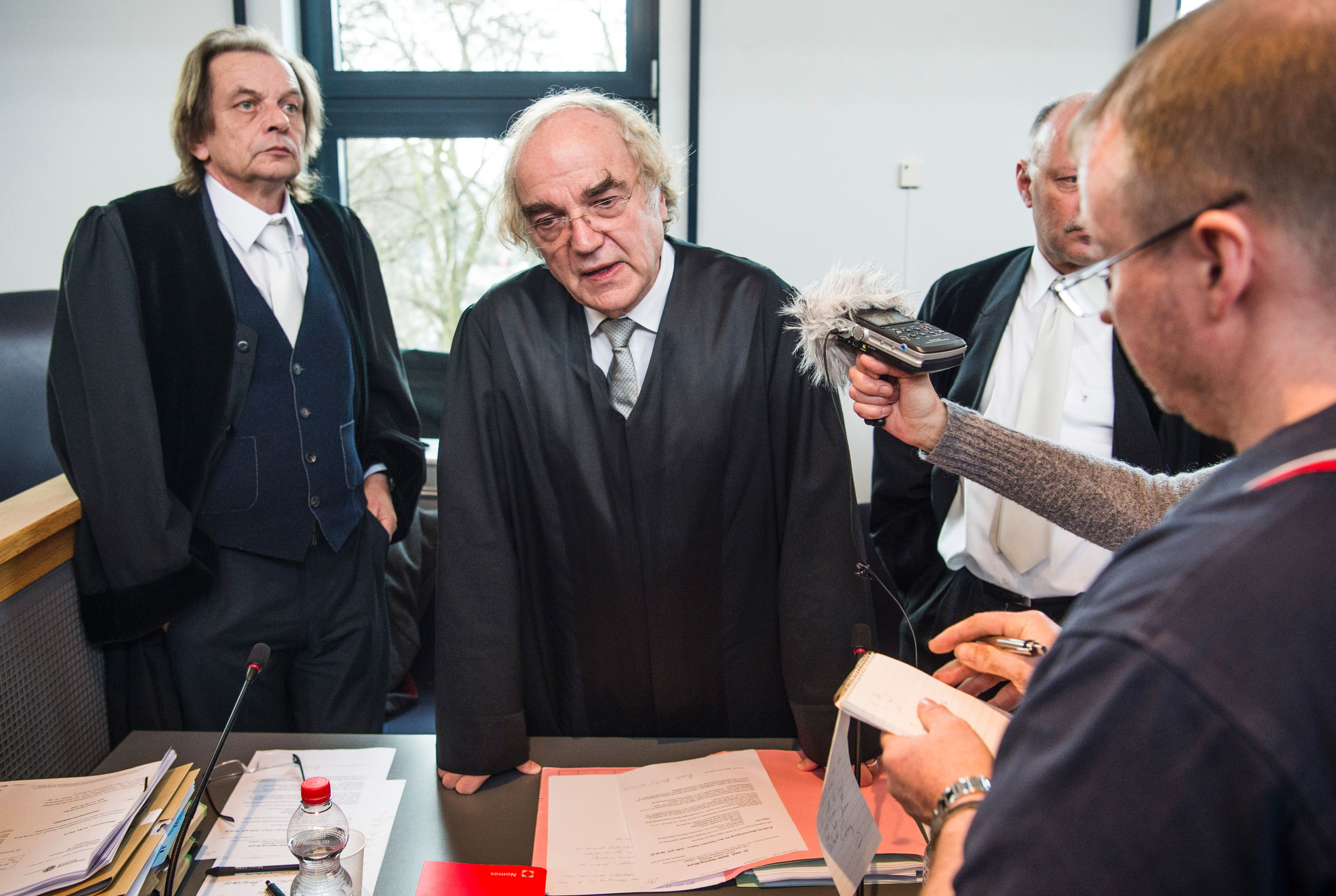 Prosecutor Thomas Walther (center) at the court on the first day of Hubert Zafke's trial, February 29, 2016.