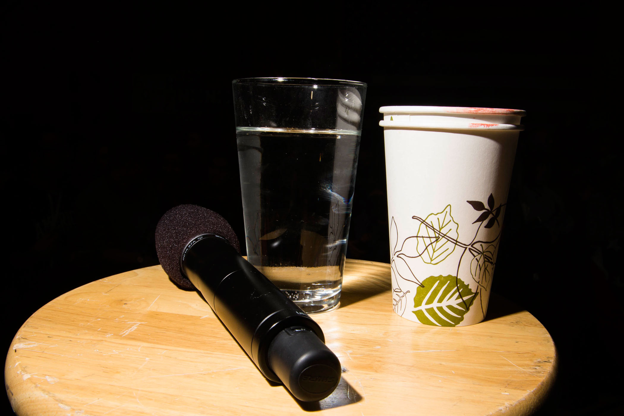A microphone and glass of water used by former Secretary of State Hillary Clinton are seen at a campaign event at Rundlett Middle School on Feb. 6, 2016, in Concord, N.H.
