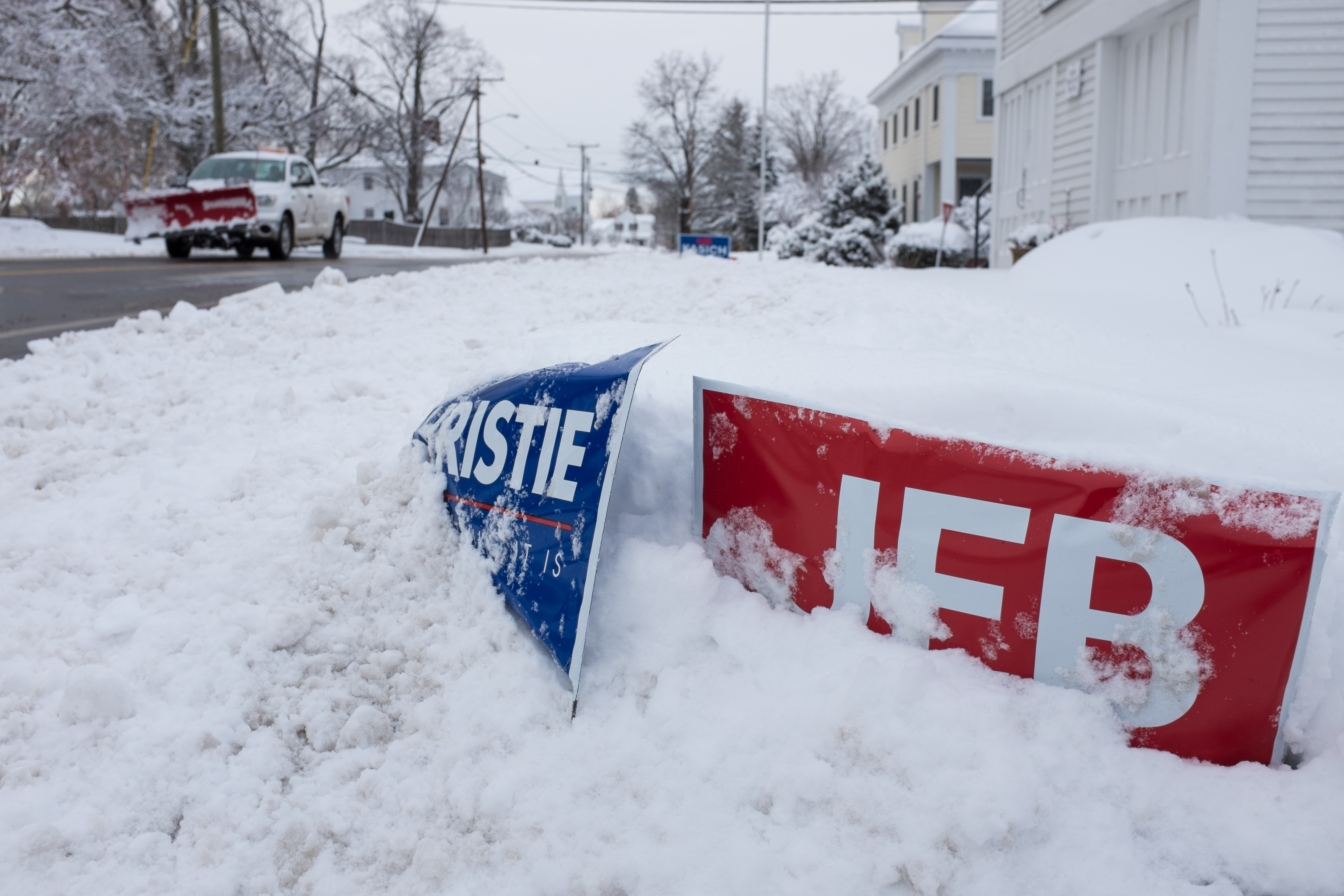 Political signs buried in snow are seen on Feb. 5, 2016 in Hollis, New Hampshire.