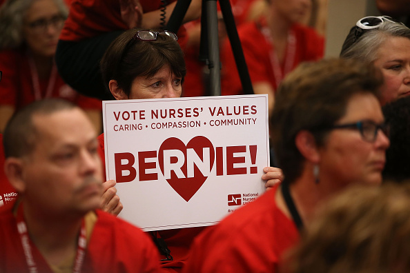 A nurse with the National Nurses United holds a campaign sign for U.S. Sen. Bernie Sanders (I-VT) on August 10, 2015 in Oakland, California.