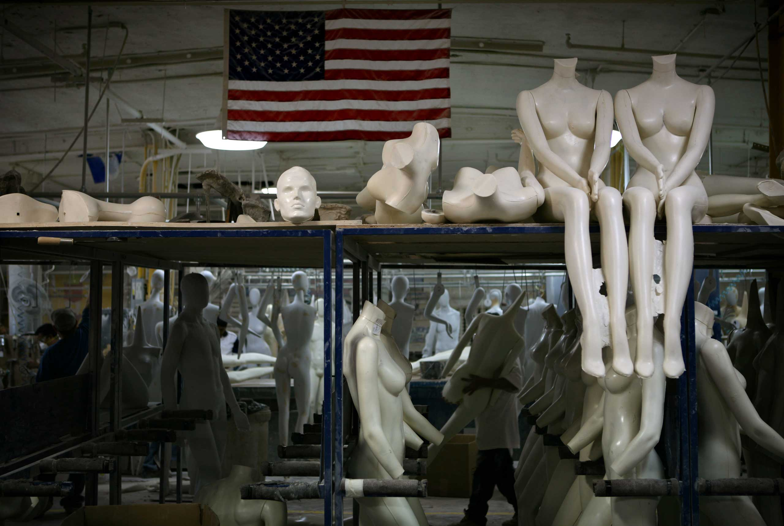 A Goldsmith employee carries a mannequin at the Goldsmith factory in New York.