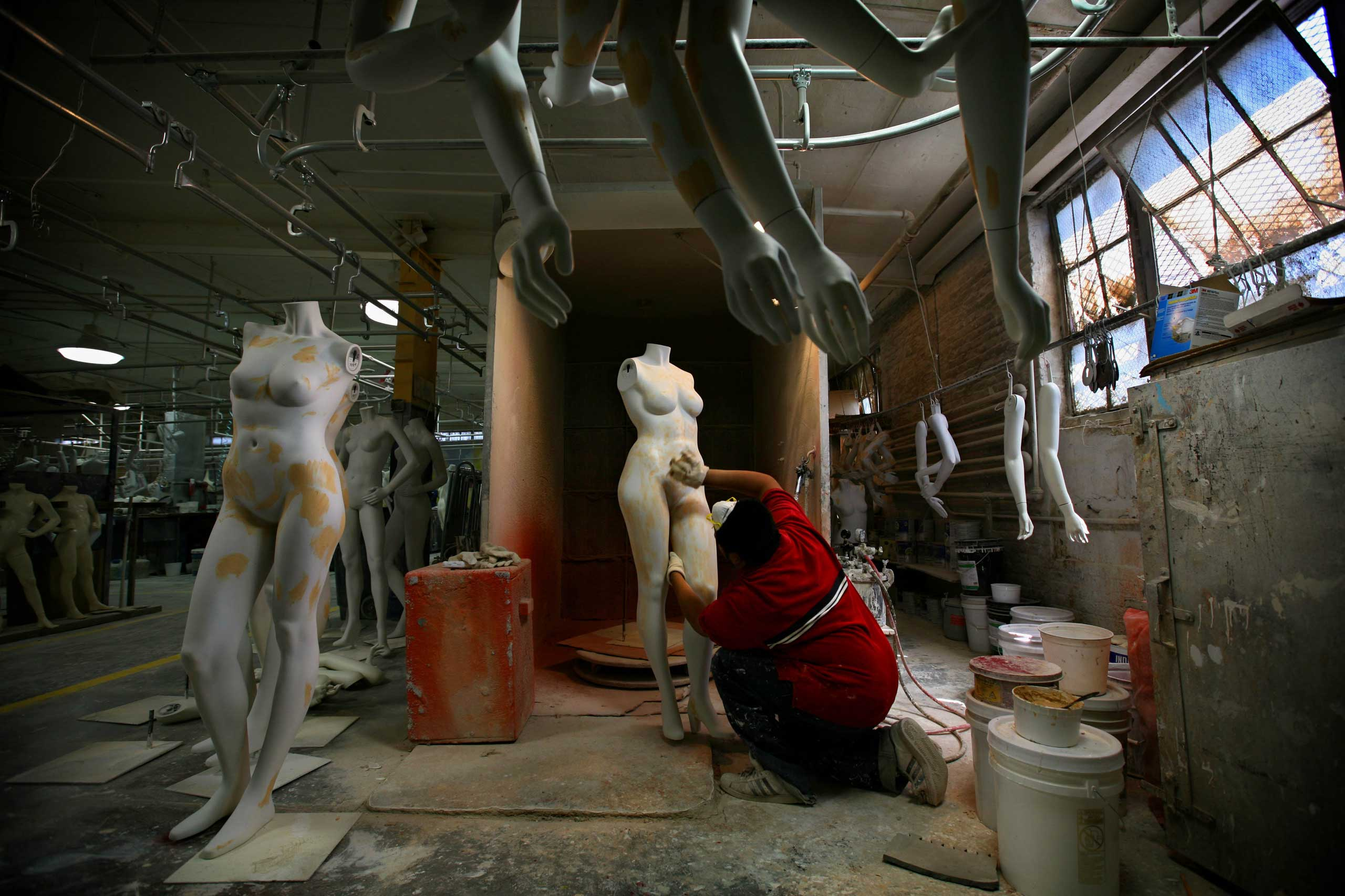 A Goldsmith employee polishes a mannequin at the Goldsmith factory in New York.