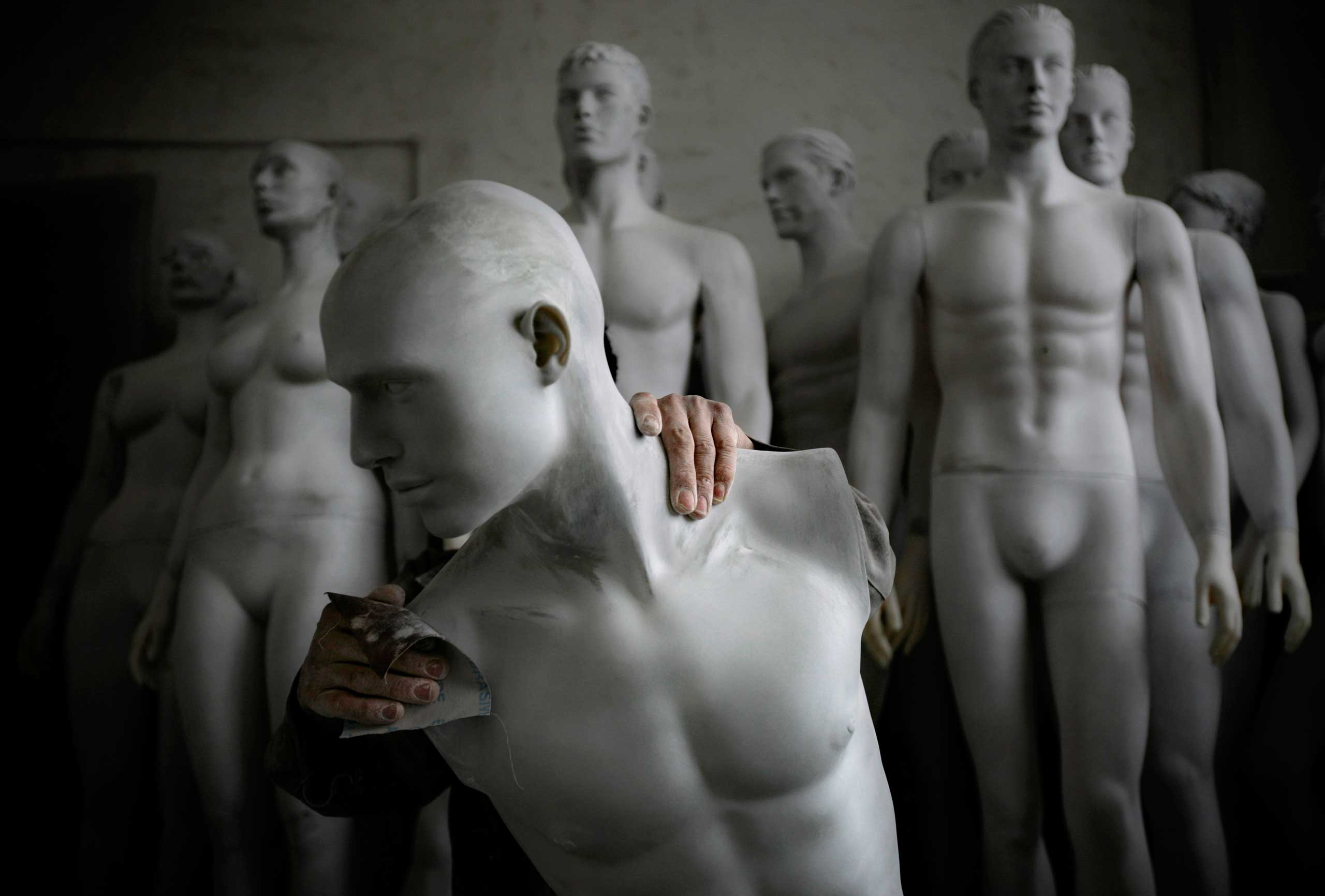 A Lucky Human mannequin factory employee polishes a mannequin, in the booming southern Chinese city of Shenzhen. The factory produces around 25,000 mannequins a year, mainly for export to Europe and the United States.