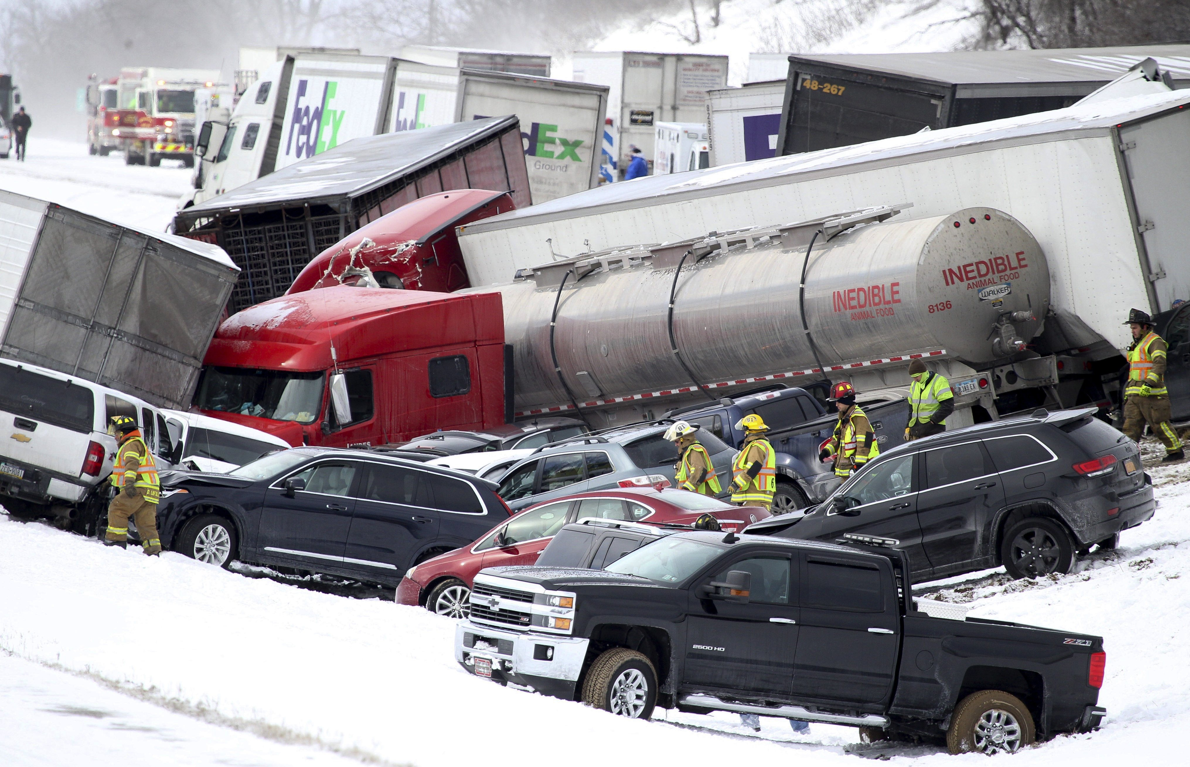 Emergency personnel work at the scene of a crash near Fredericksburg, Pa. on Feb. 13, 2016.