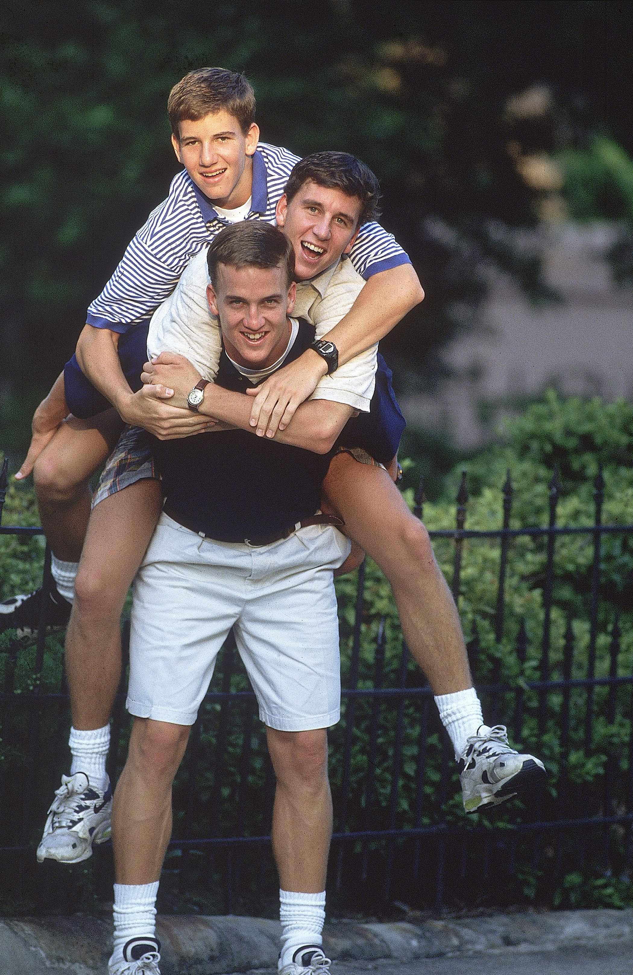 Tennessee quarterback Peyton Manning carrying brothers Eli and Cooper on back.                                   New Orleans, LA 7/11/1996                                   MANDATORY CREDIT: Bill Frakes/Sports Illustrated                                   SetNumber: X51068