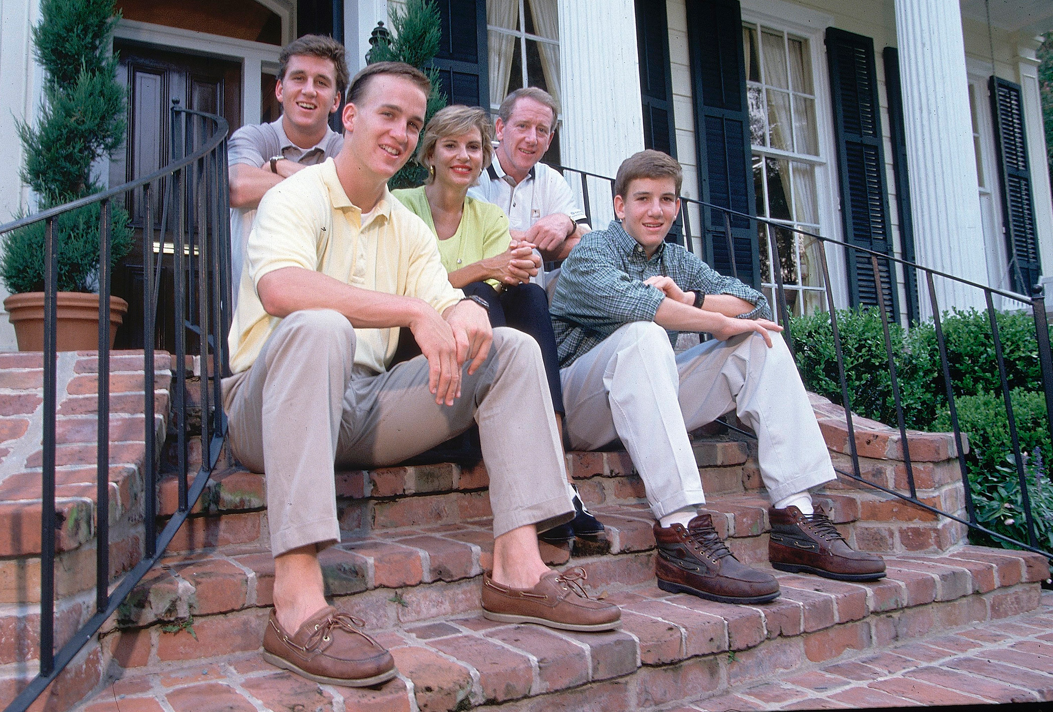 From front left, Peyton Manning poses for a portrait with brother Cooper, mother Olivia, father Archie and brother Eli at their home in                                   New Orleans in July 1996.
