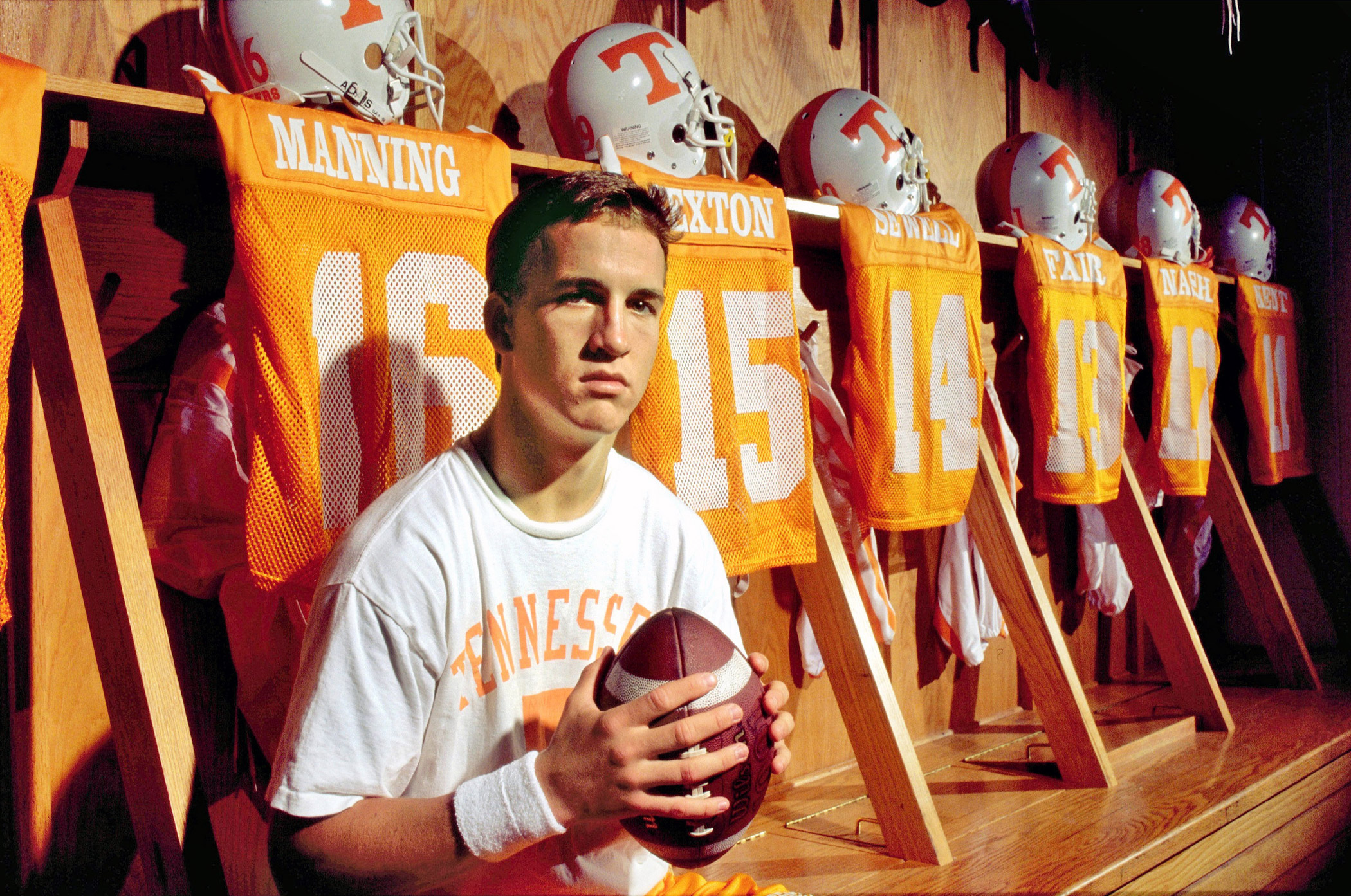 Peyton Manning played quarterback in college football with the Tennessee Volunteers, seen here in the locker room circa 1995 in Knoxville, Tenn.