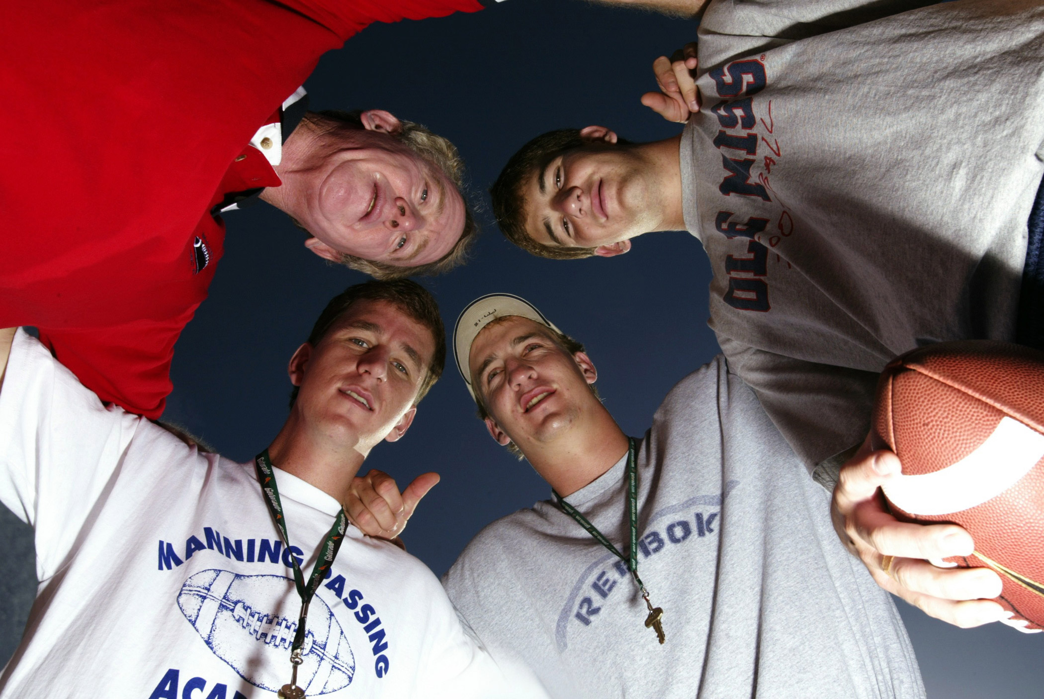 The Mannings pose for a portrait at the  Manning Passing Academy in 2003. Clockwise from top left are Archie, Eli, Peyton and Cooper.