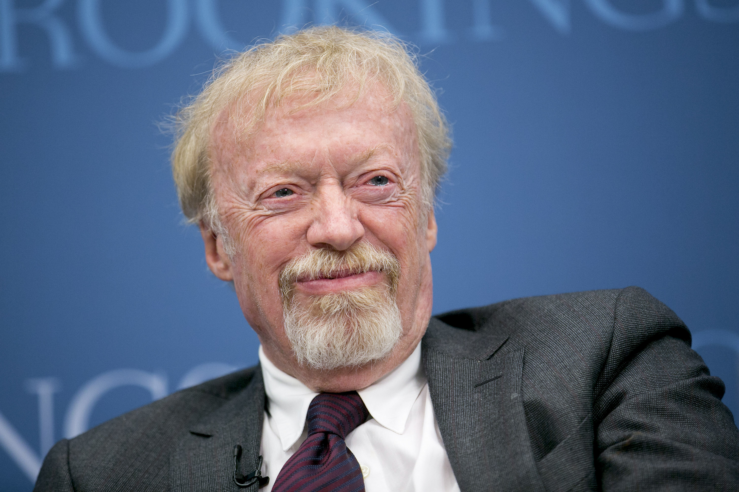 Phil Knight, chairman and co-founder of Nike Inc., laughs during a panel discussion at the Brookings Institution in Washington, D.C., U.S., on Tuesday, Jan. 15, 2013.