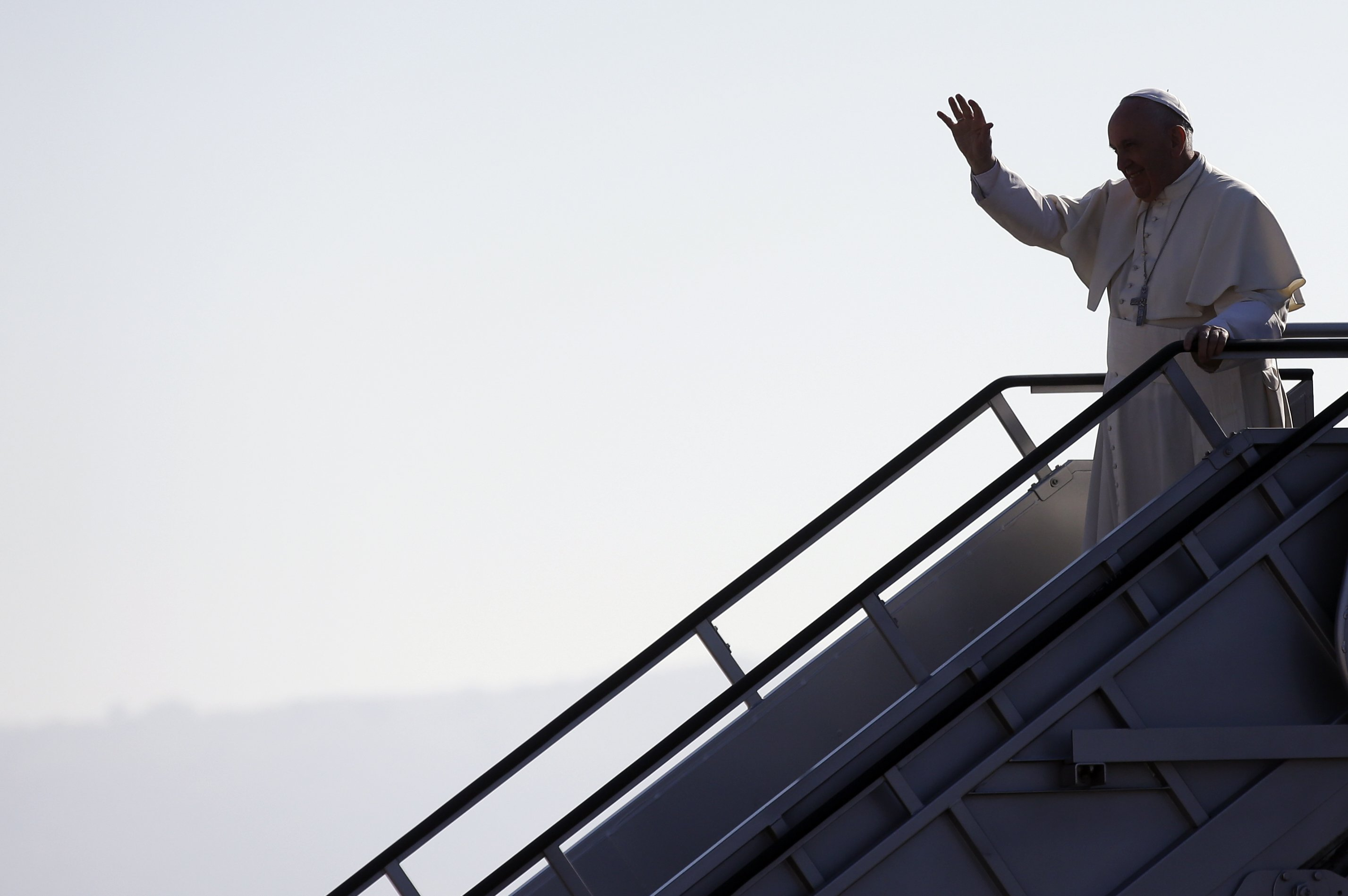 Pope Francis waves upon his arrival at the airport in Tuxtla Gutierrez, Mexico, on Feb. 15, 2016.