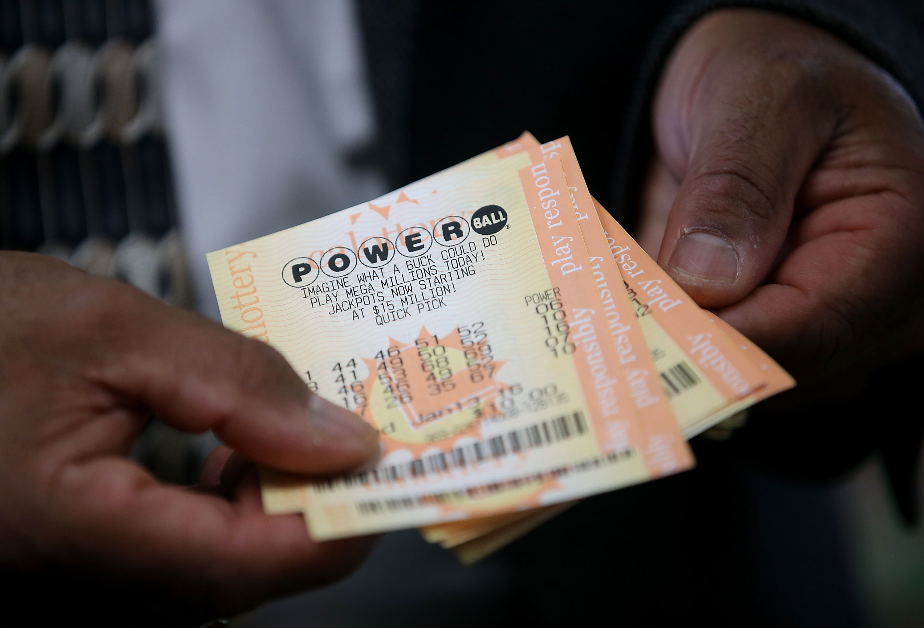 A customer holds Powerball tickets that he purchased at Kavanagh Liquors on January 12, 2015 in San Lorenzo, California.
