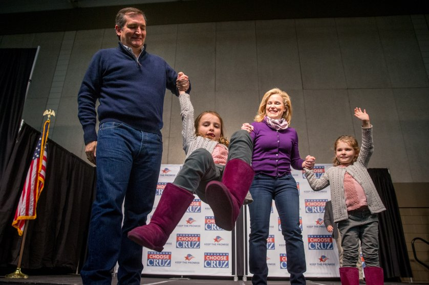 Republican presidential candidate ,Texas Sen. Ted Cruz and his wife Heidi swing their daughter Caroline, 7, as their daughter Catherine, 4, waves at a rally in Waterloo, Iowa, on Jan. 23, 2016
