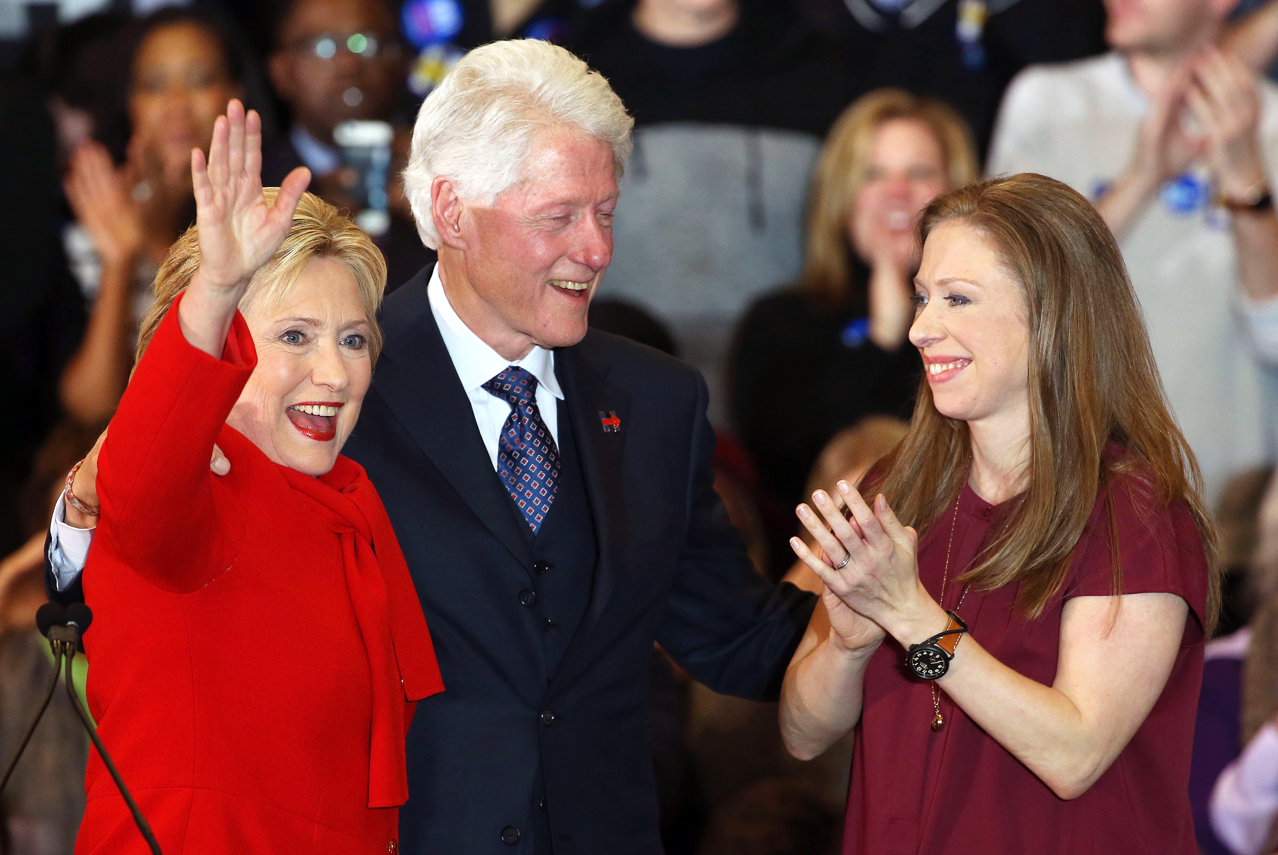 Democratic presidential candidate, former Secretary of State Hillary Clinton, waves to supporters as  husband and former President Bill Clinton and daughter Chelsea Clinton cheer at her caucus night event on Feb. 1, 2016 in Des Moines, Iowa.