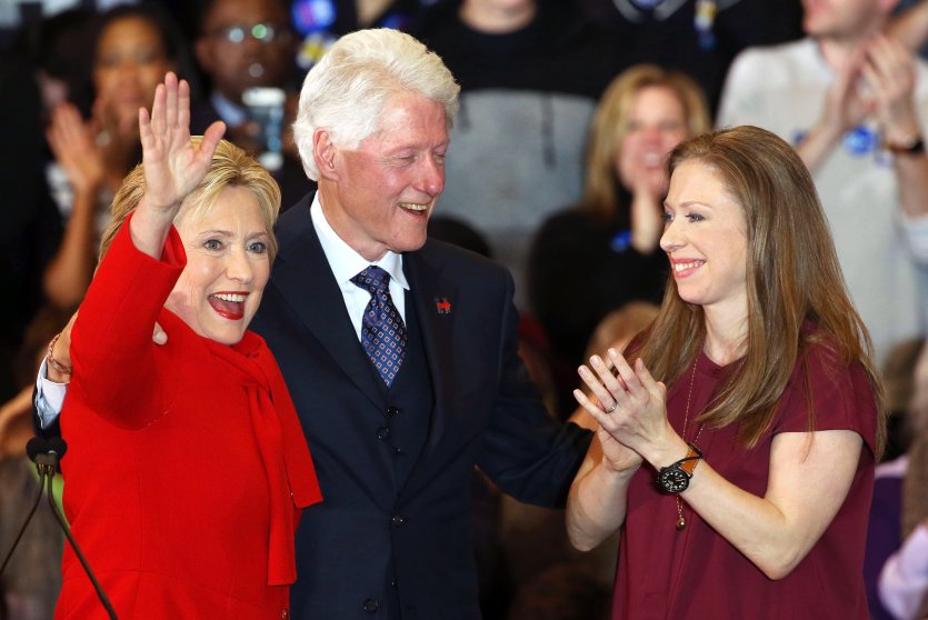 Democratic presidential candidate, former Secretary of State Hillary Clinton waves to supporters as husband and former President Bill Clinton and daughter Chelsea Clinton cheer at her caucus night event on Feb. 1, 2016 in Des Moines, Iowa.