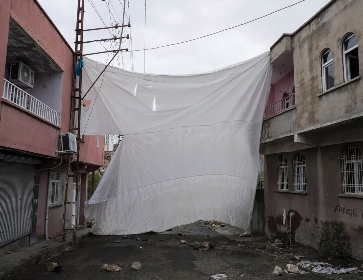 SILVAN, TURKEY - OCTOBER 27, 2015: A veil covers an entrance in the Tekel neighborhood. Since July the town of Silvan has been subjected to several curfews and teather of heavy clashes between Turkish military forces and Kurdish youh militia. A number of neighborhoods declared autonomy and built self-rule, with groups of young Kurds under the acronyms of HPG (People Defense Union) and YDGH (Patriotic Revolutionary Youth Movement) who have taken up arms and raise barricades to prevent the advances of the Turkish forces.