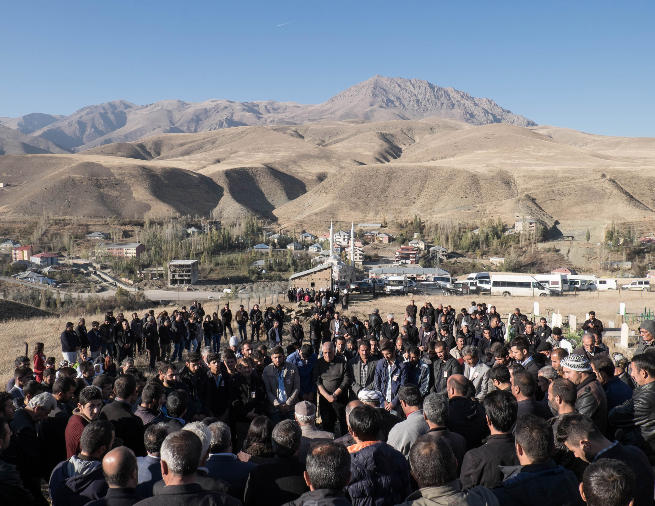 The burial of Inan Tarsun, a PKK guerrilla who died during a clash with the Turkish army on the Qandil mountains. Relatives and friends commemorate his death at the PKK grave yard in Esendere, a small town on the border with Iran in the Hakkari province of Turkey, on Nov. 4, 2015. Since July, the region has seen a surge in violence with daily clashes between the Turkish army and the militants from the outlawed Kurdistan Workers Party (PKK). The escalation has shattered a two-year ceasefire that had raised hopes of an end to three decades of fighting, in which more than 40,000 people have been killed.