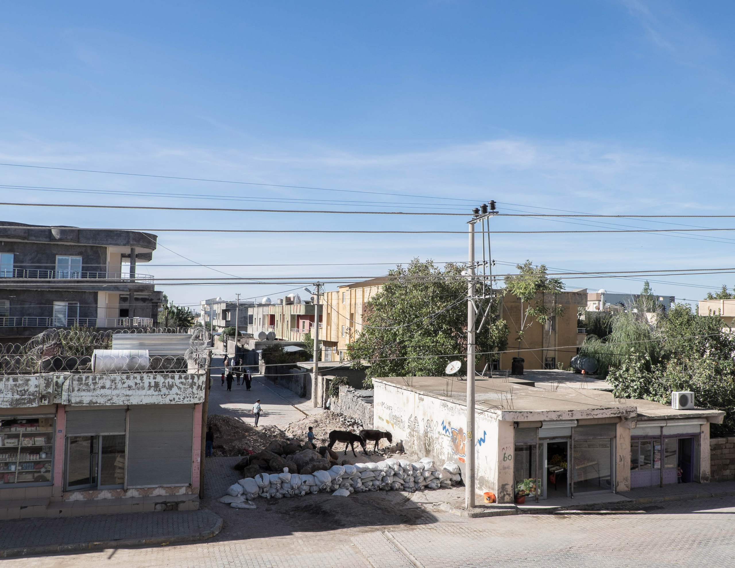 Barricades at an entrance to Turgut Ozal, a self declared autonomous neighborhood of Idil, on Oct. 30, 2015. Since July, several neighborhoods in the town have declared autonomy and self-rule, and groups of young Kurds have taken up arms and raised barricades to prevent the advances of the Turkish forces.