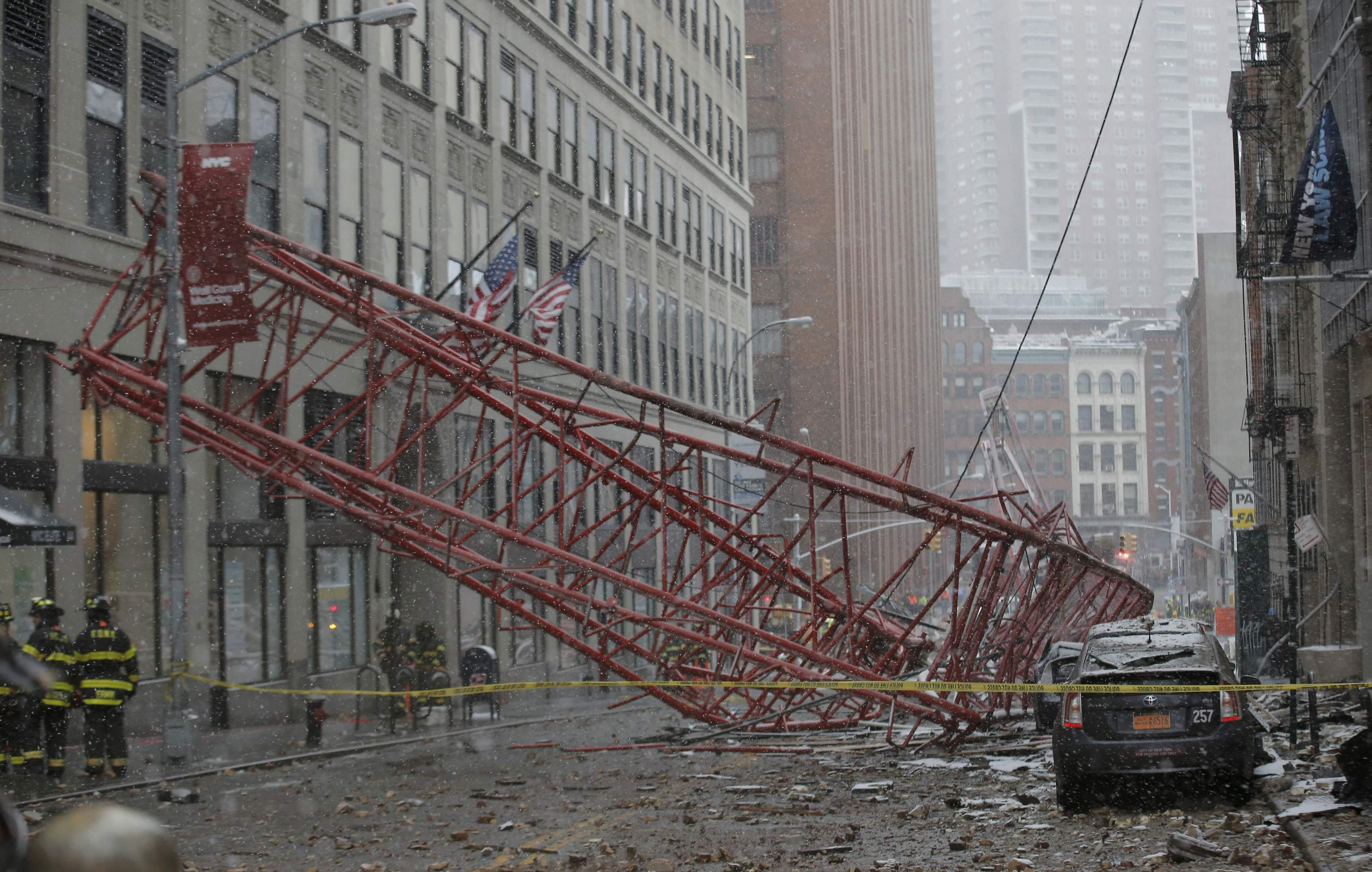 Emergency crews survey a massive construction crane collapse on a street in downtown Manhattan in New York City, on Feb. 5, 2016.
