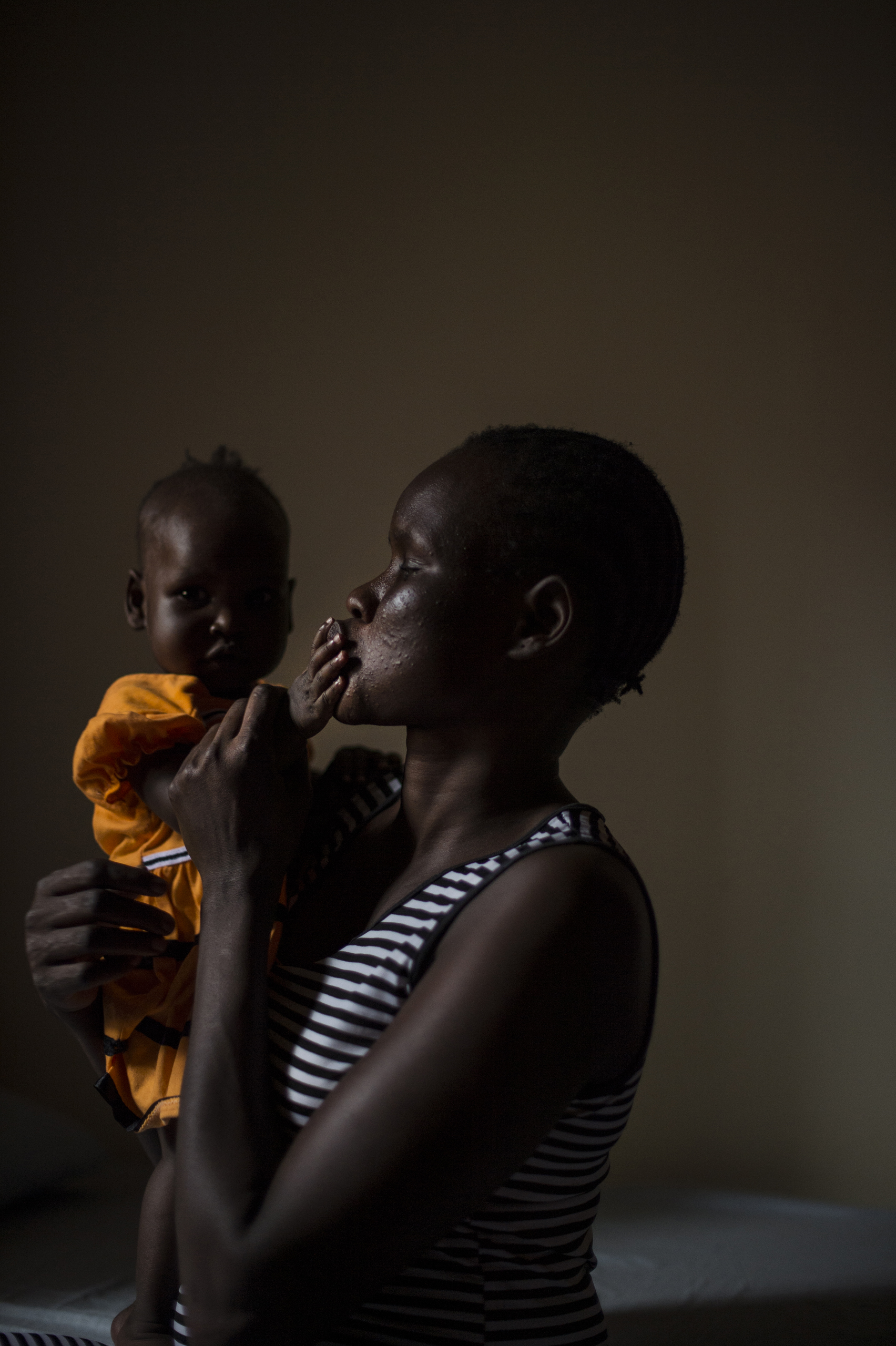 Mary, 27, holds her six-month old daughter, Nyakwat, who was born after Mary was raped repeatedly at a U.N. camp in South Sudan by different men. She now lives in a safe house in Uganda, Dec. 8, 2015.Mary, a member of the Nuer tribe, watched as her husband and her two sons were killed in front of her by  soldiers of the Dinka tribe. Five of them held her down as three others raped her 10-year-old daughter who died hours later.The soldiers, who also raped Mary, told her that they considered the Nuers in the camps to be rebels, and that they killed her sons because they couldn't risk letting them grow up to be fighters.Mary made her way to a U.N. camp for civilians displaced by war where she lived for a year and was raped by soldiers who made their way into the camp.