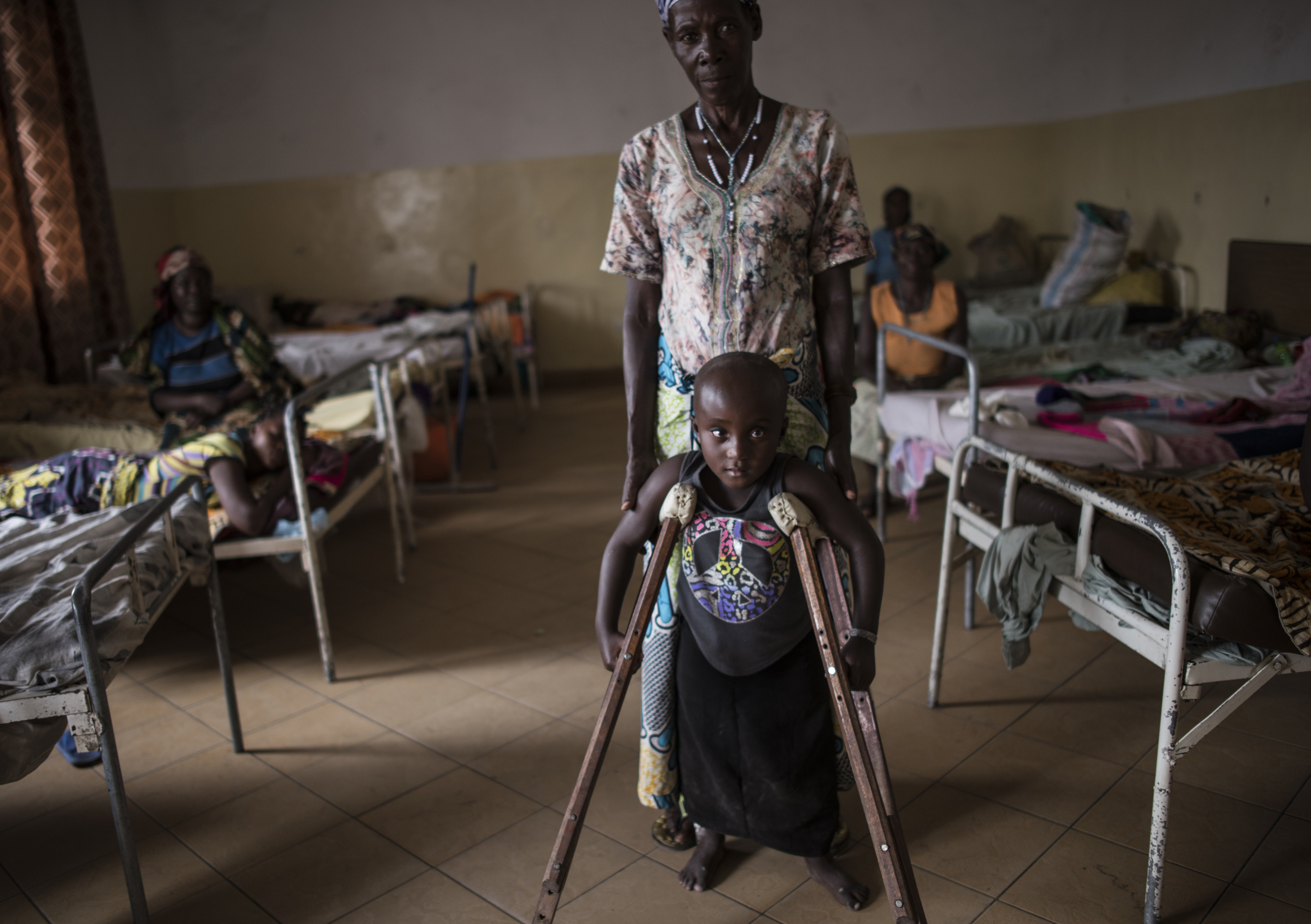 Kanyere Neema, 7, with her grandmother, Ndahondi Domina, 53, in the Heal Africa hospital in Goma, the Democratic Republic of Congo, Dec. 5, 2015.Two years prior, Kanyere's village of Ishasha was attacked by armed men, and her parents were killed in front of her. She was raped so many times by different men that she was left paralyzed, and stopped speaking.