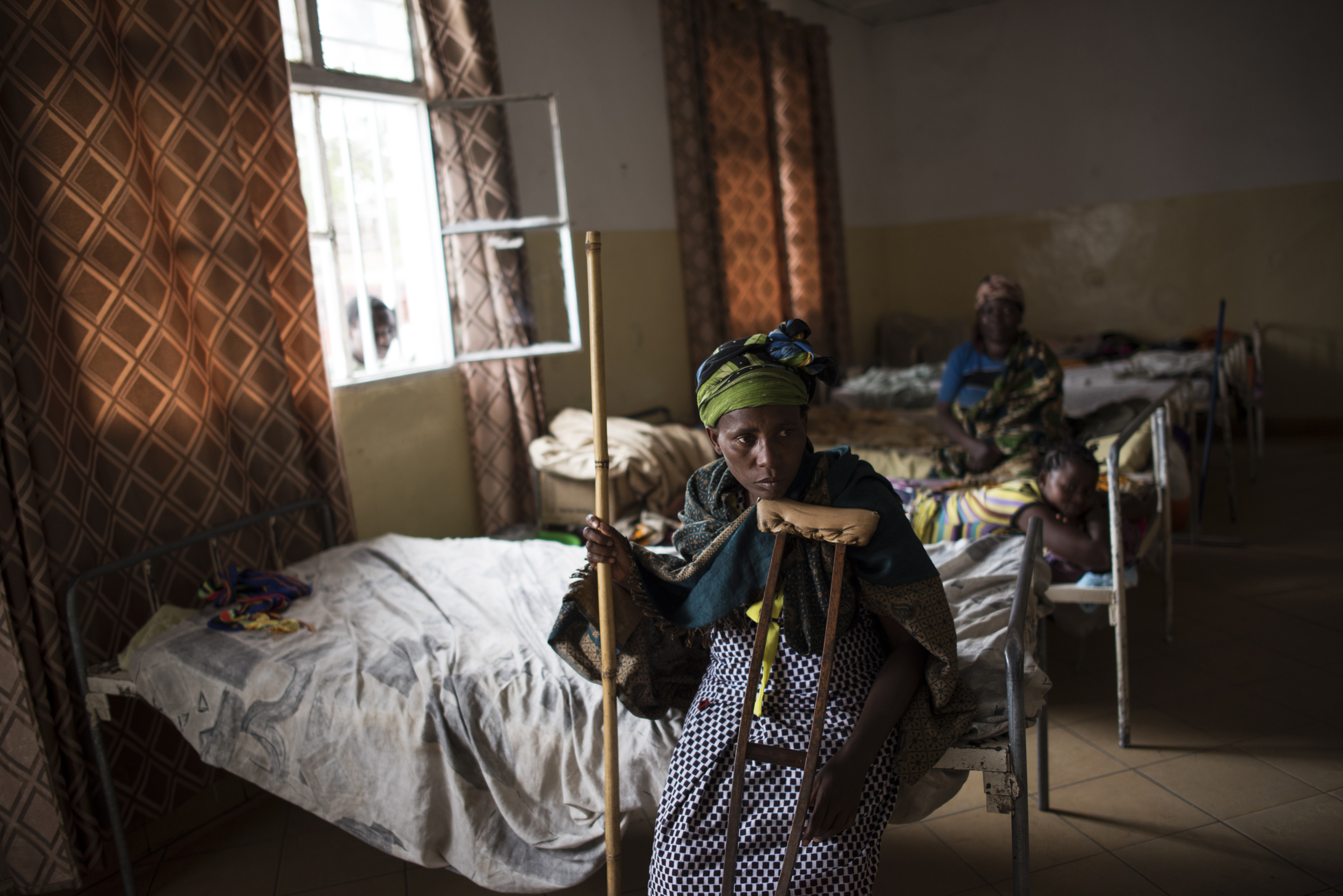 Ferediana Kimanimbaye sits with crutches after recently re-breaking her leg and returning to the Heal Africa Hospital in Goma, the Democratic Republic of Congo, Dec. 5, 2015. Ferediana was gang-raped by soldiers of the Democratic Forces for the Liberation of Rwanda (FDLR), a Hutu rebel group in eastern DRC, when they attacked her village more than seven years ago. They killed her husband, and three different men raped her. She fell and broke her leg while she was escaping.