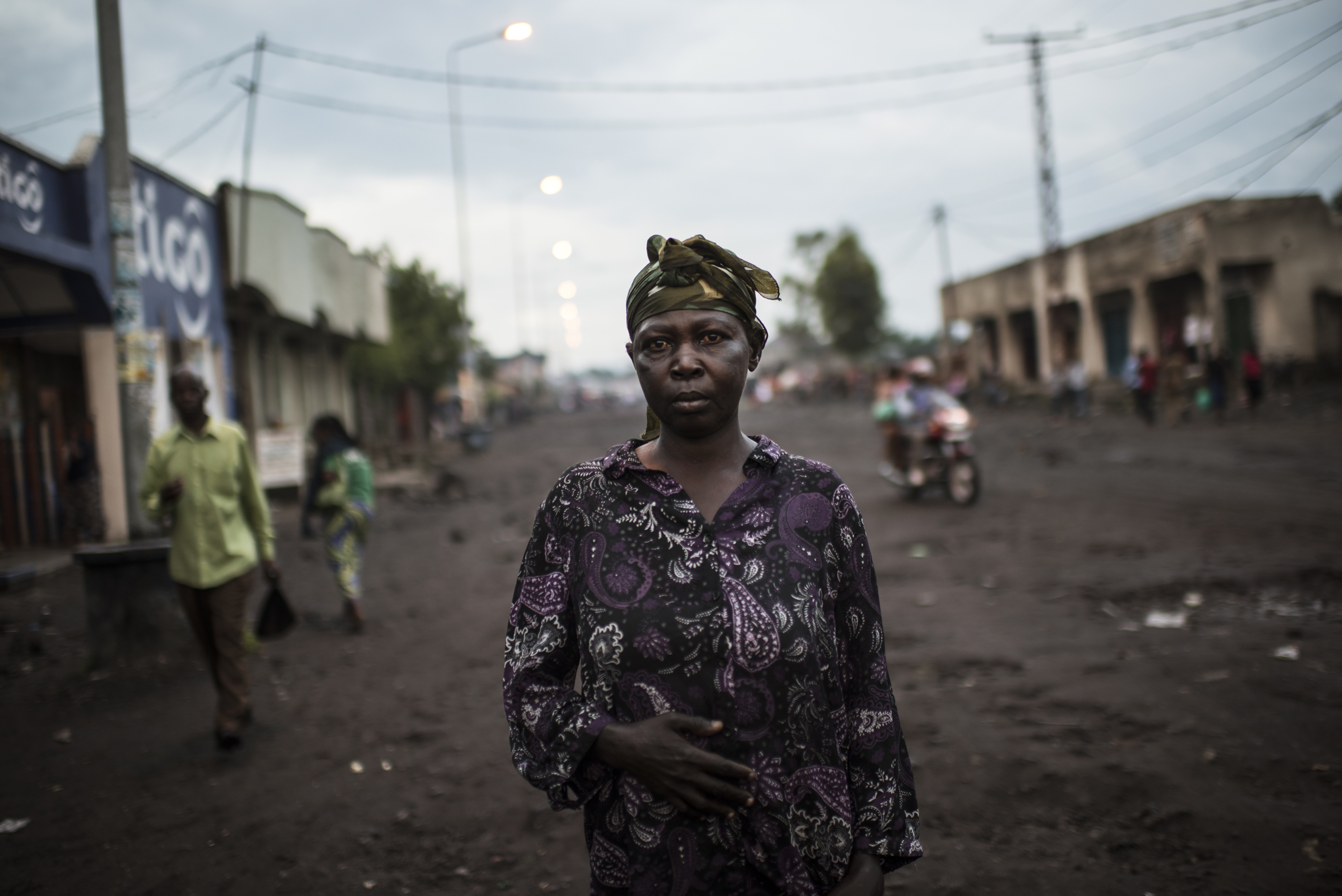 "Josephine Mwamini, 42, was raped in 2010, in her village, Walikali, by soldiers of the Democratic Forces for the Liberation of Rwanda (FDLR), a Hutu rebel group in eastern DRC.They killed her husband and son, and took her to the forest, where they tied her to the ground. Seven different men raped her, and they left her for dead. Her neighbors found her  and sent her to Goma to the HEAL Africa Hospital, where she stayed for two years, getting multiple fistula surgeries.She went back home in 2012, but then, in June 2015, armed men attacked her village again. The soldiers raped her multiple times, and once again she was taken to Heal Africa for surgery, where she learned that she had been infected with HIV. She has three daughters ages nine to 19, alone in the village and  fears that something might happen to them. ""They rape any women they find, they don't care about the age, how old or young they might be. They rape whoever is in their path."""
