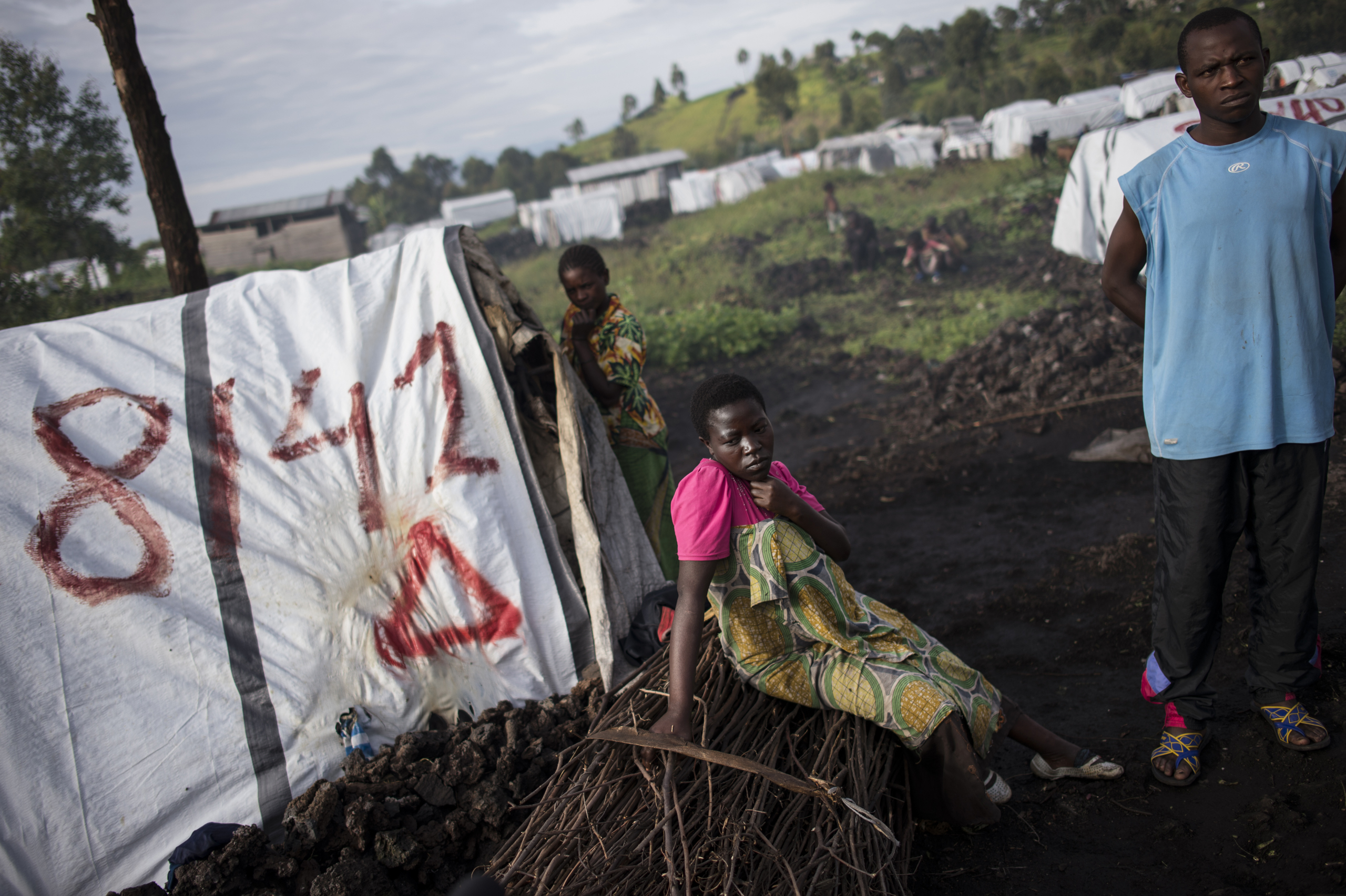 Maiombi Thomas,16, sits alongside her brother, Innocent Kongomani, 22, in the Mugunga 1 camp for internally displaced people, outside Goma,  the Democratic Republic of Congo, Dec. 5, 2015. Maiombi became pregnant after she was raped by a ranger when she went to get firewood outside the camp.