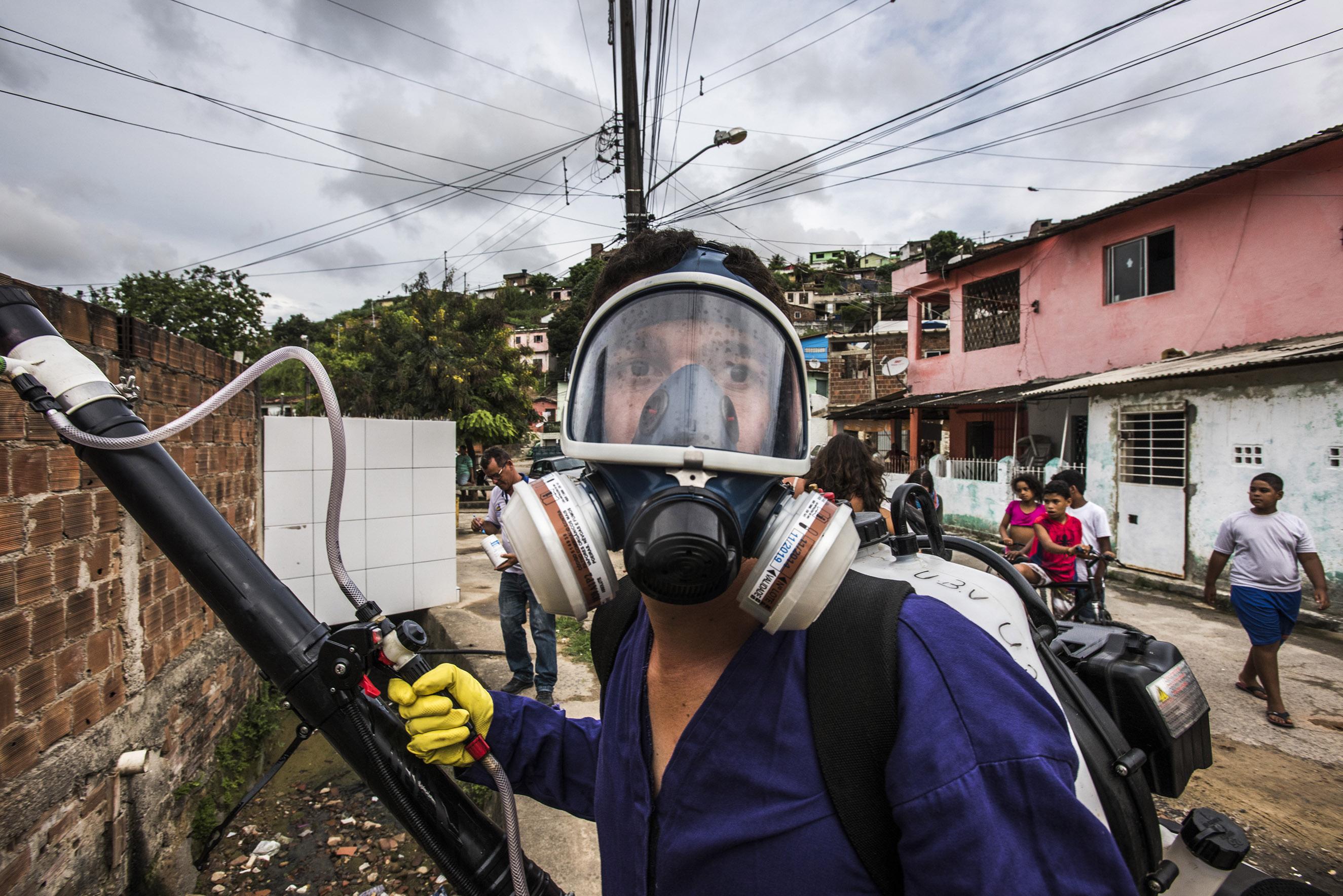 A health worker sprays insecticide in the Nova Descoberta neighborhood of Recife, Brazil, Feb. 1, 2016. Recife became Ground Zero for the outbreak of Zika cases.