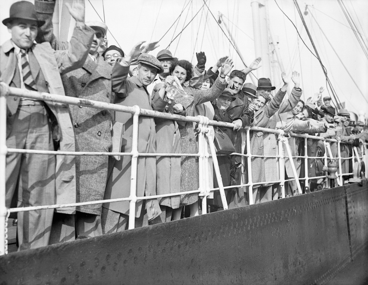 Hundreds of German-Jewish refugees, Britain's share of the 907 who sailed for weeks in search of a home, land at Southampton in 1939.