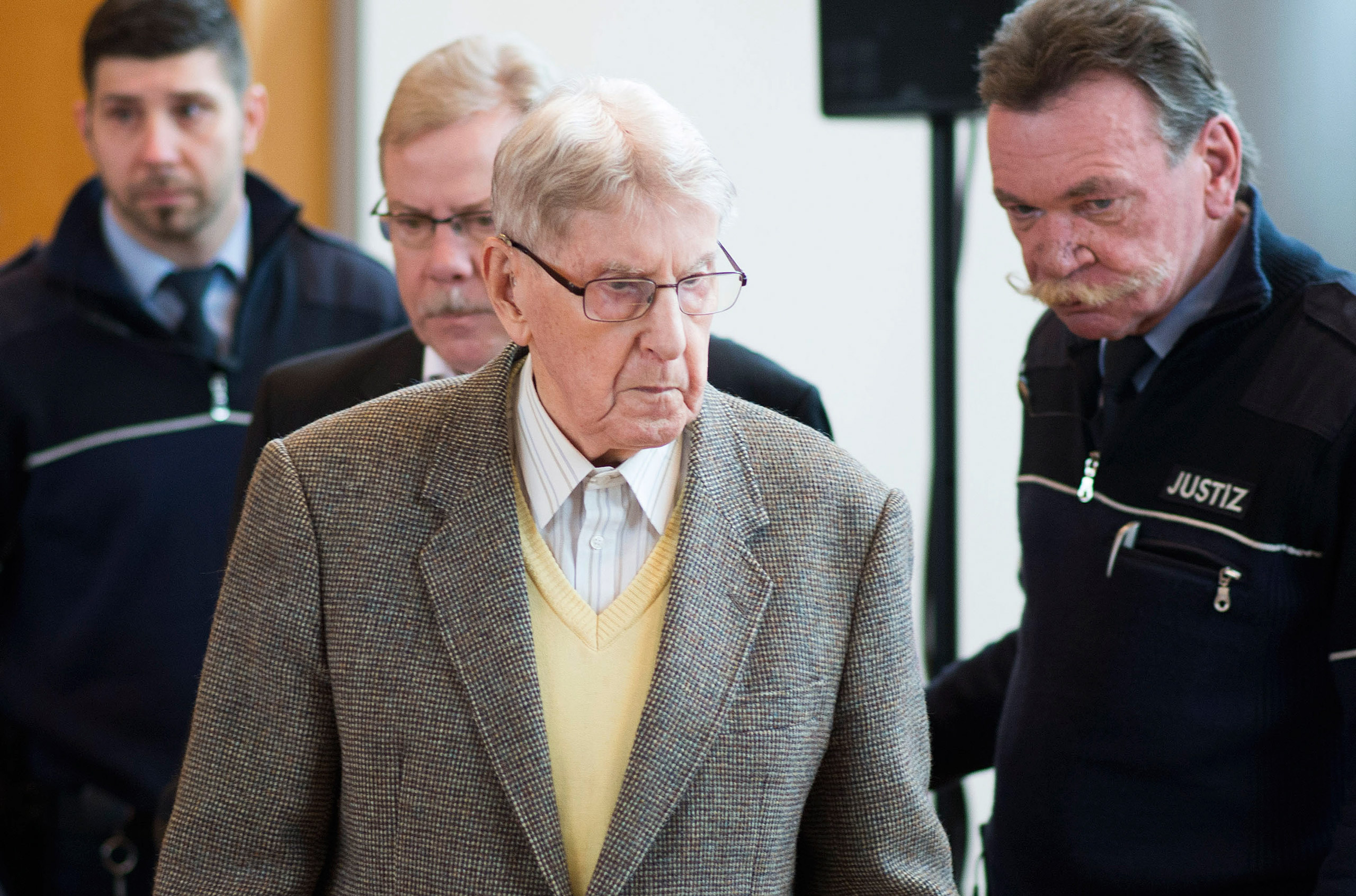 Reinhold Hanning, a 94-year-old former guard at Auschwitz, arrives in the courtroom before his trial in Detmold, Germany, on Feb. 12, 2016.