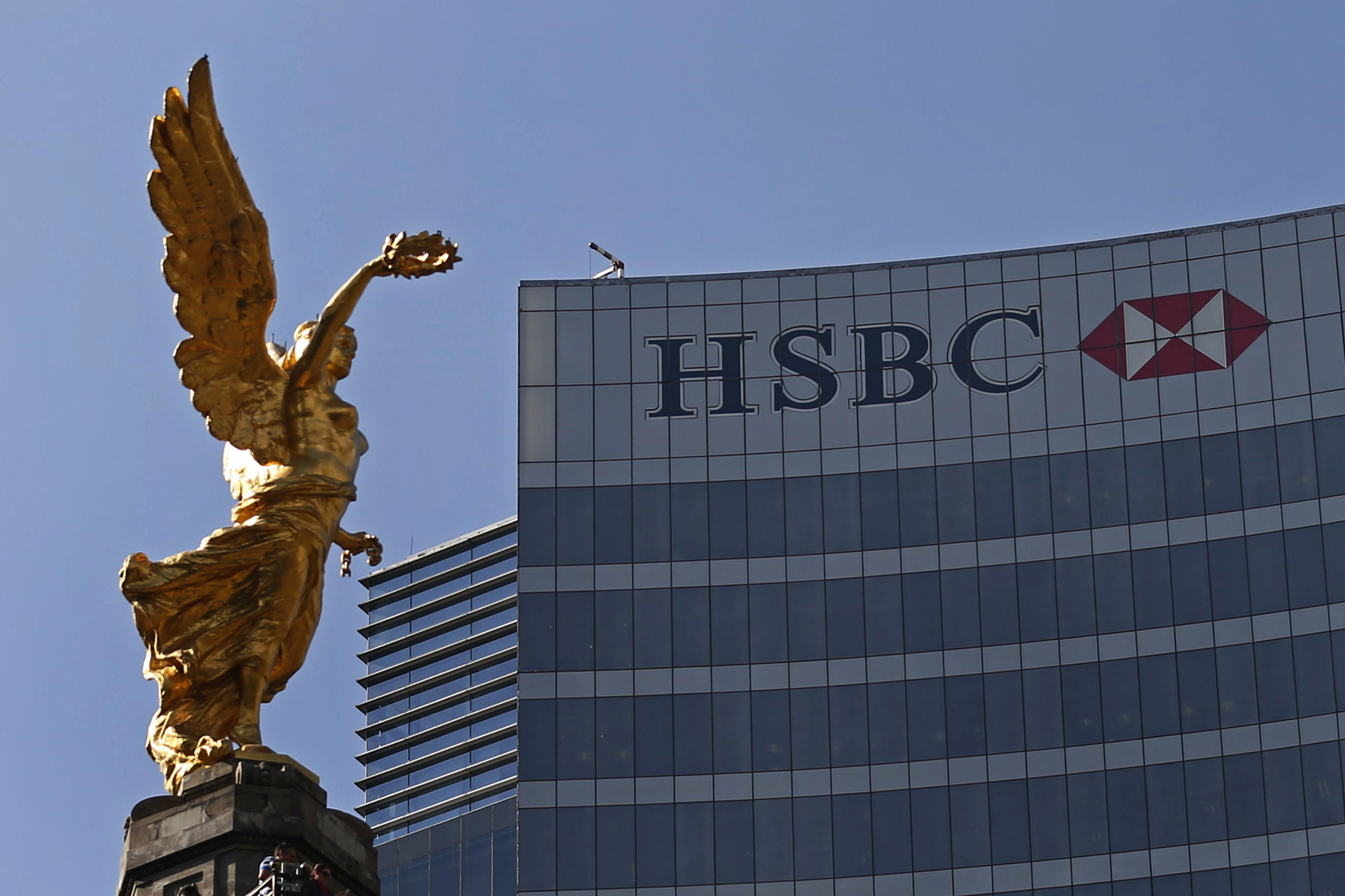 The Angel of Independence monument is seen near a building of HSBC in Mexico City January 23, 2015.