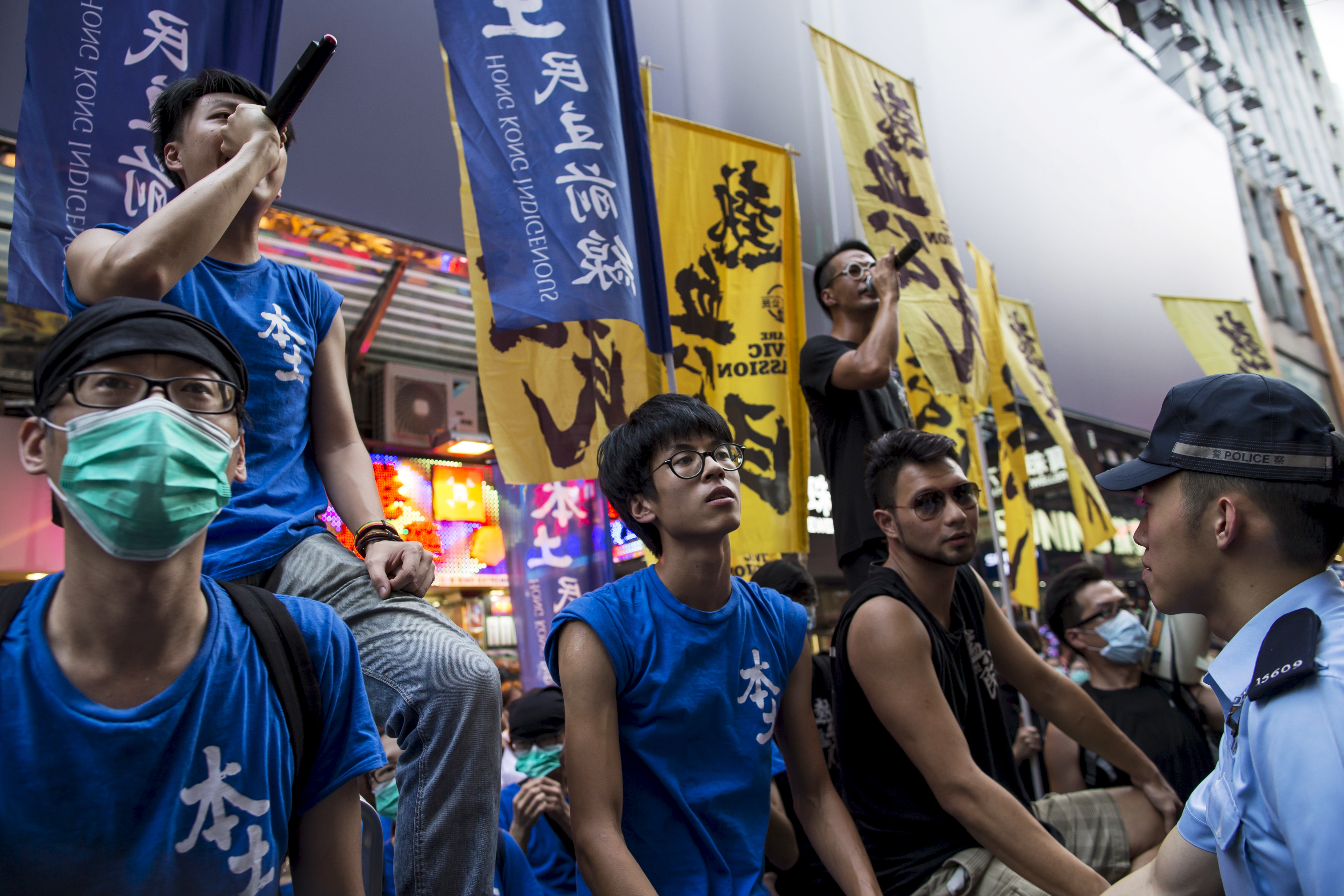Localist protesters shout to pro-China demonstrators during an anti-China protest at Mong Kok shopping district in Hong Kong on July 11, 2015