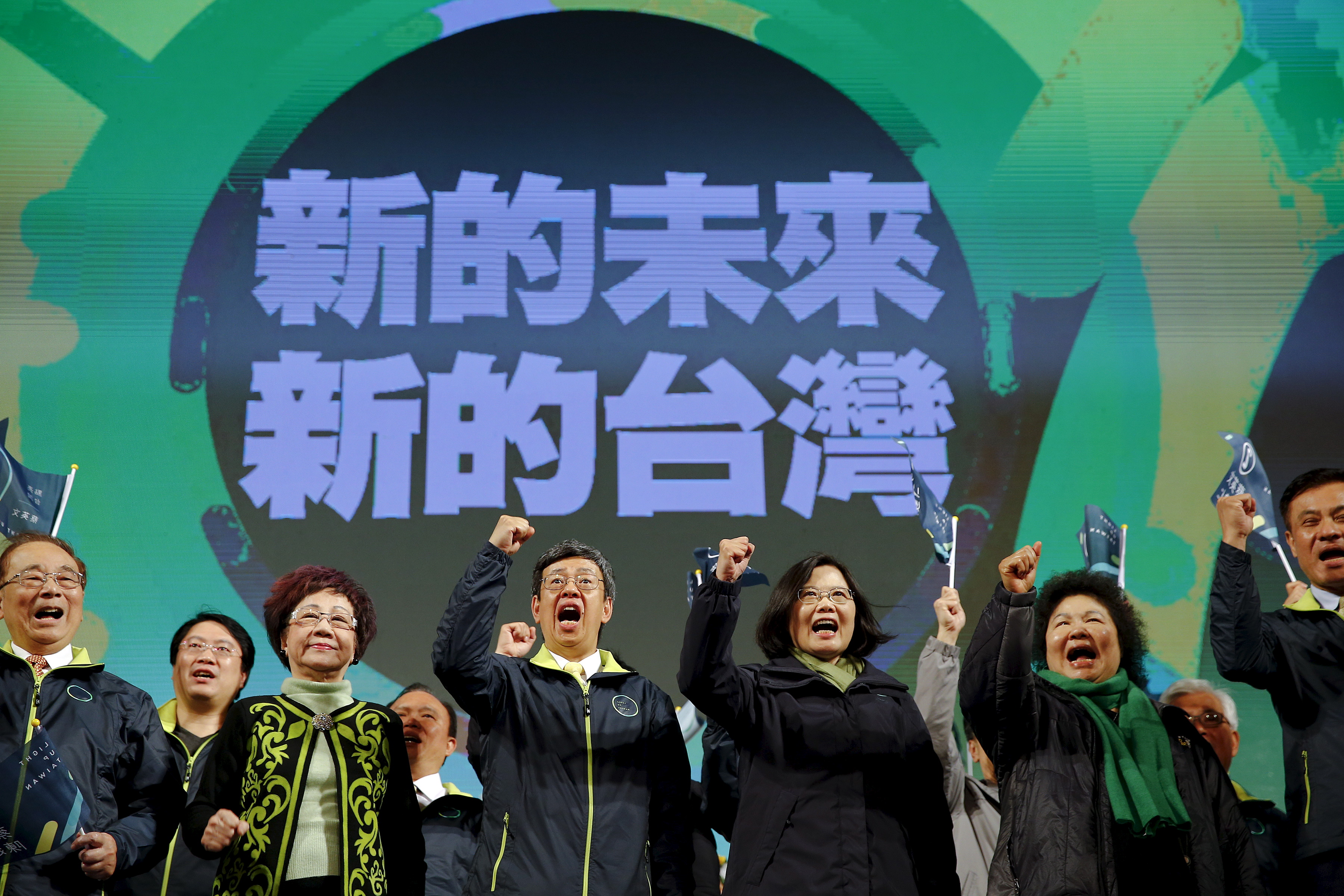 Democratic Progressive Party chairperson and presidential candidate Tsai Ing-wen, third from right, celebrates her election victory with other party members at the DPP's headquarters in Taipei on Jan. 16, 2016