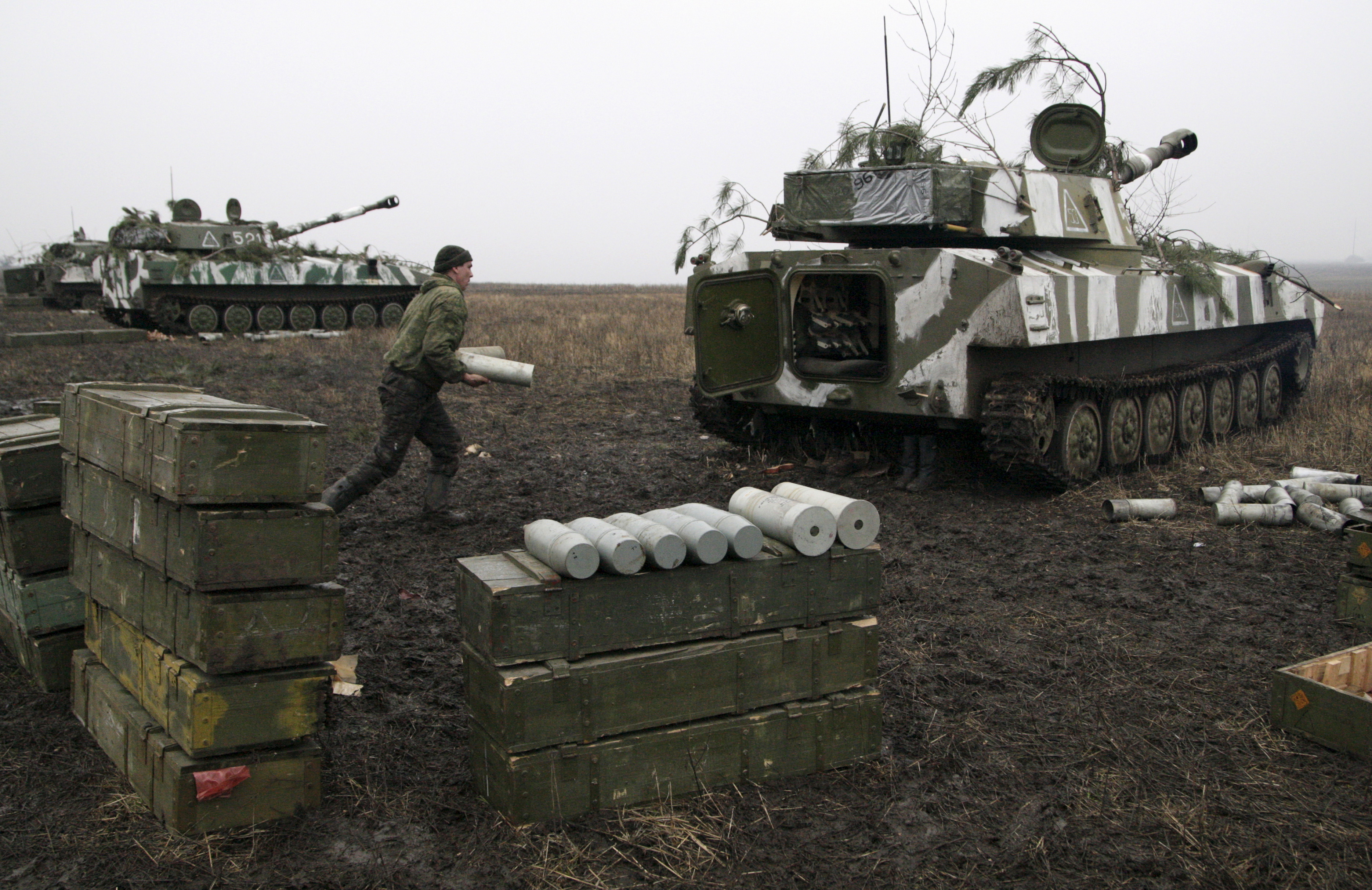 A member of the self-proclaimed Donetsk People's Republic forces loads a shell onto a self-propelled artillery gun during tactical training exercises in Donetsk region, Ukraine, on Feb. 4, 2016