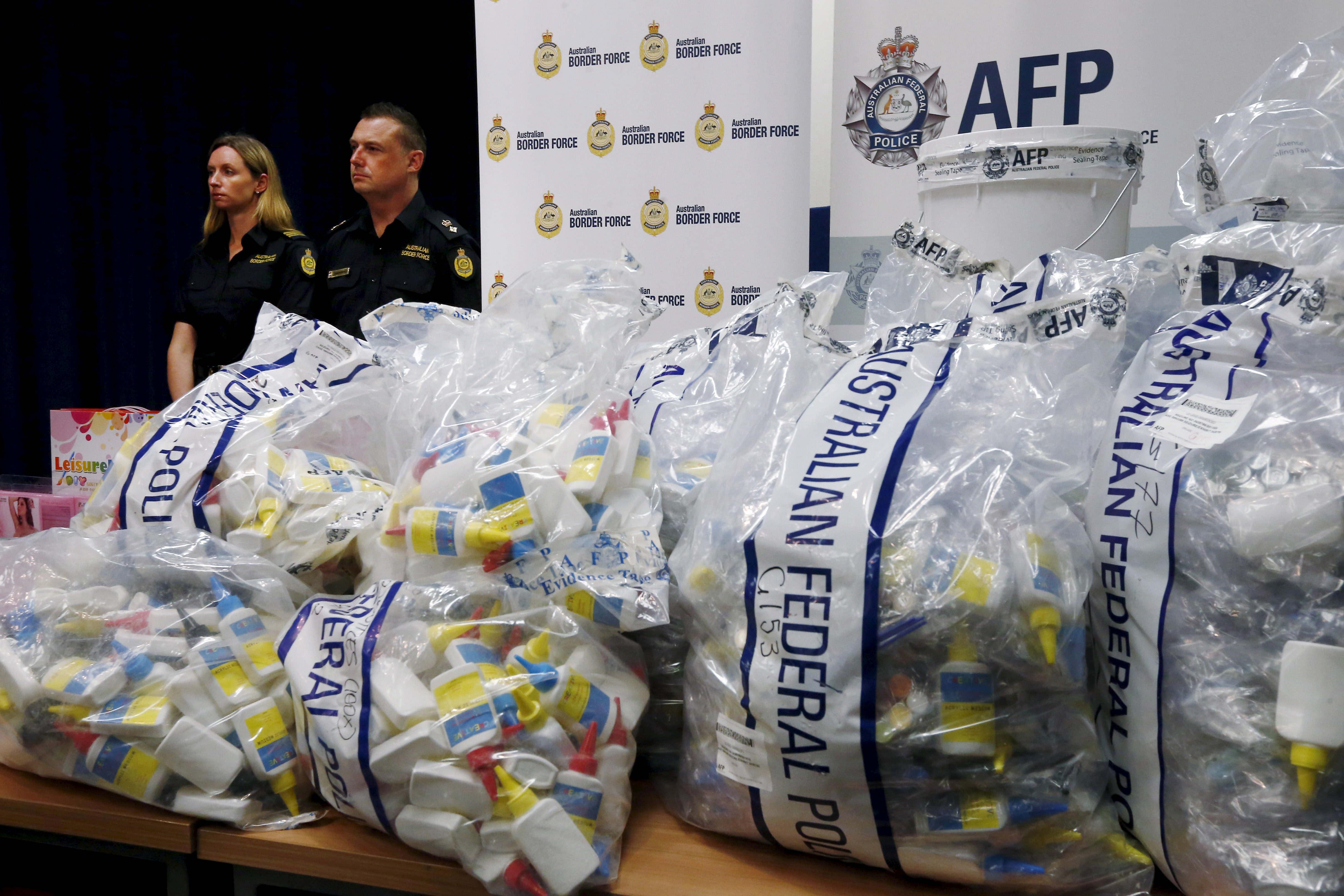 A quantity of liquid methamphetamine disguised in various packaging is put on display by Australian Border Force officers at the Australian Federal Police headquarters in Sydney on Feb. 15, 2016