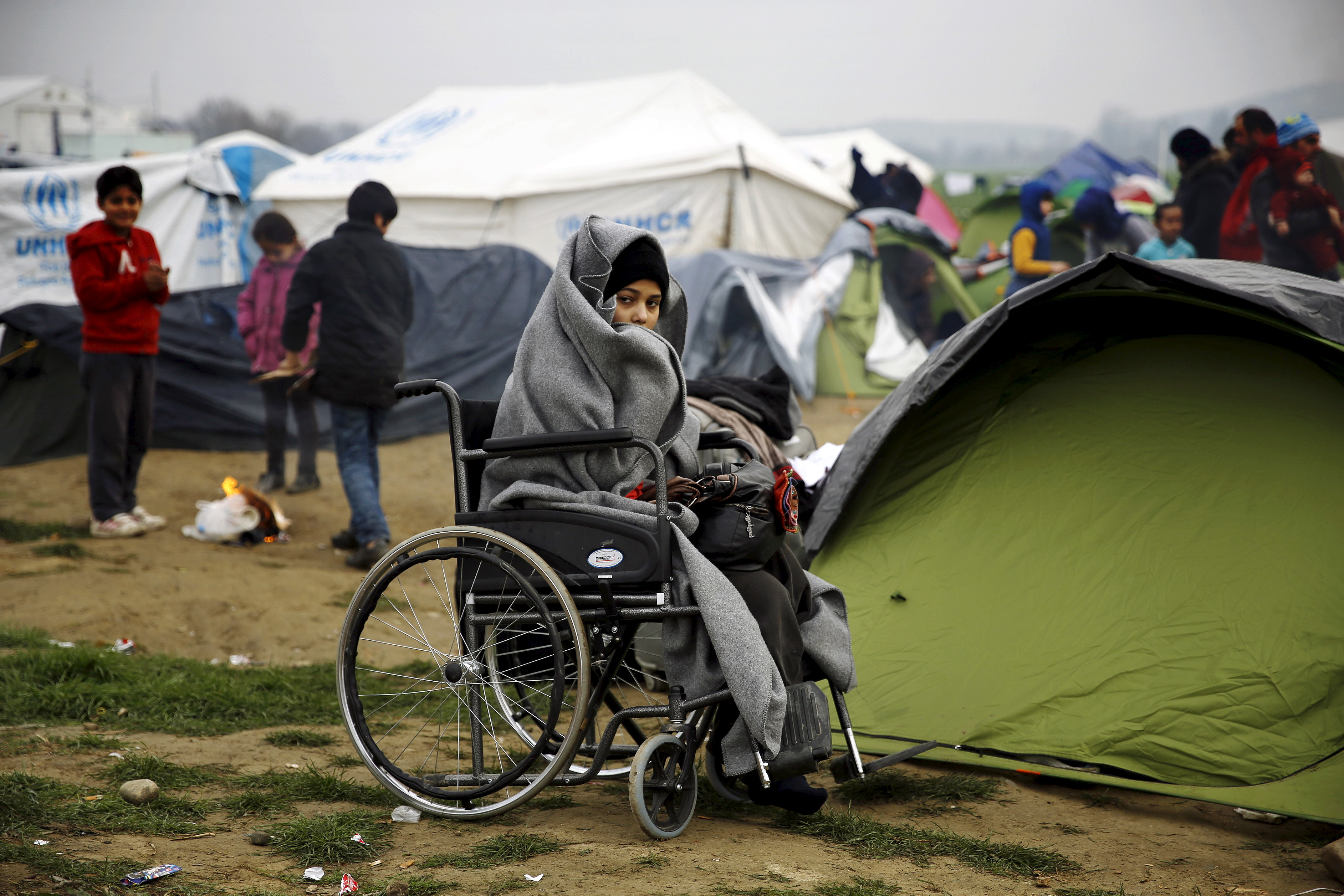 A temporarily stranded Syrian refugee is seen on a wheelchair at a makeshift camp near the Greek village of Idomeni, next to the border with Macedonia, on Feb. 24, 2016