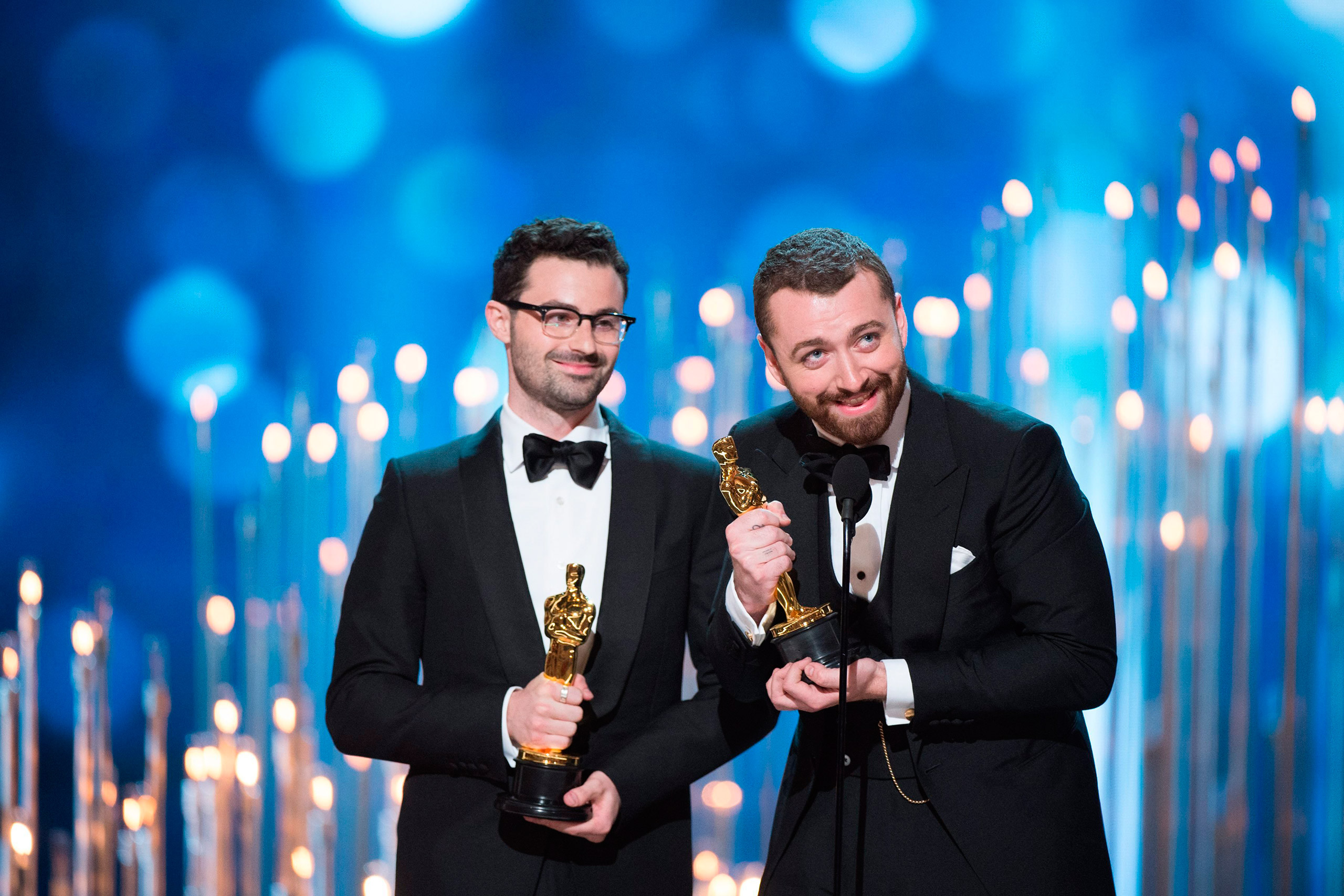 A handout image provided by the Academy of Motion Picture Arts and Science shows Jimmy Napes (left) and Sam Smith (right) accepting the Oscar for Best Original Song for  Writing's On The Wall  from SPECTRE during the 88th annual Academy Awards ceremony at the Dolby Theatre in Hollywood, Calif., Feb. 28, 2016.